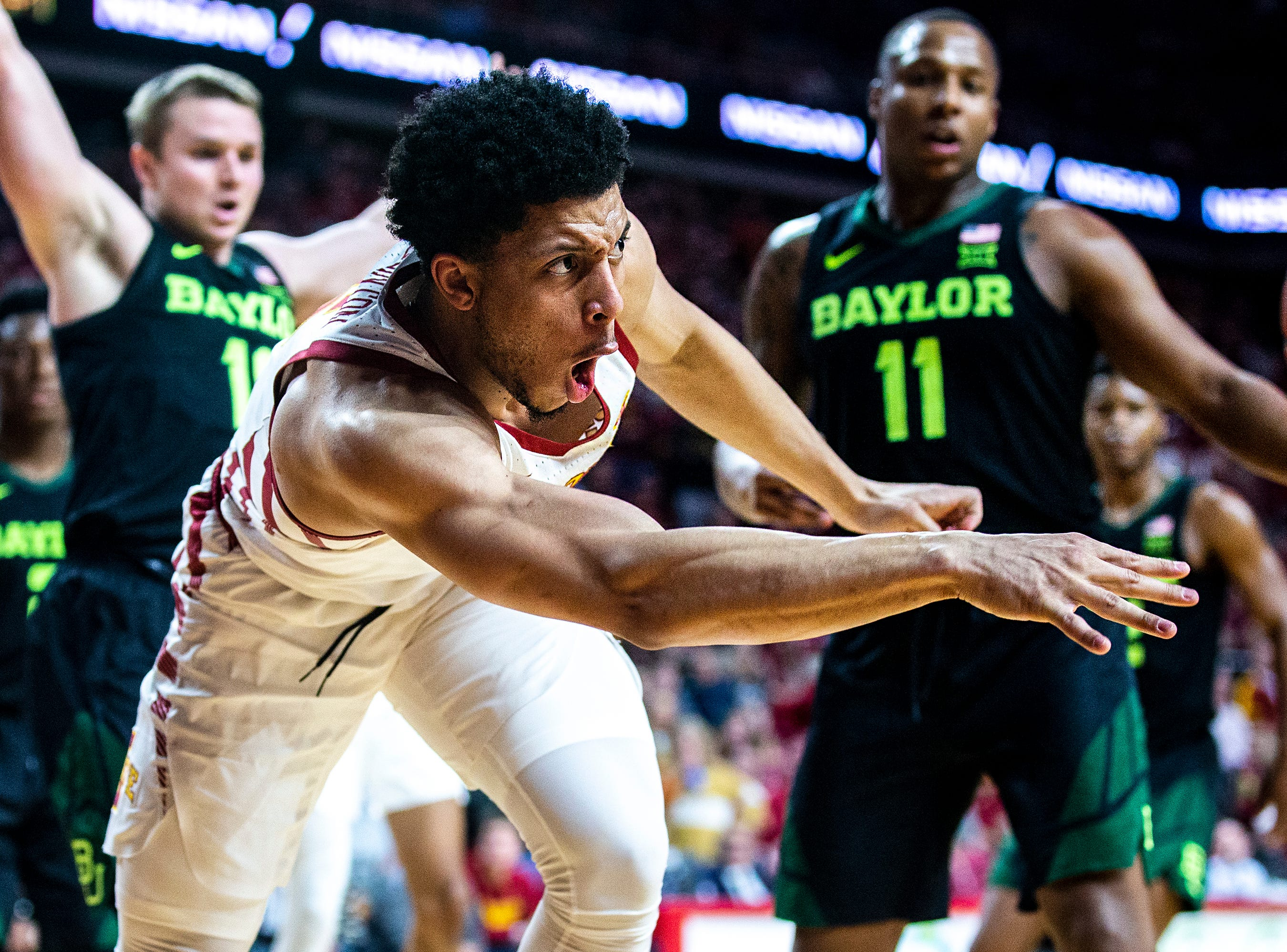 Iowa State's Lindell Wigginton makes a pass during the Iowa State men's basketball game against Baylor on Tuesday, Feb. 19, 2019, in Hilton Coliseum. The Cyclones fell to the Bears 69-73.