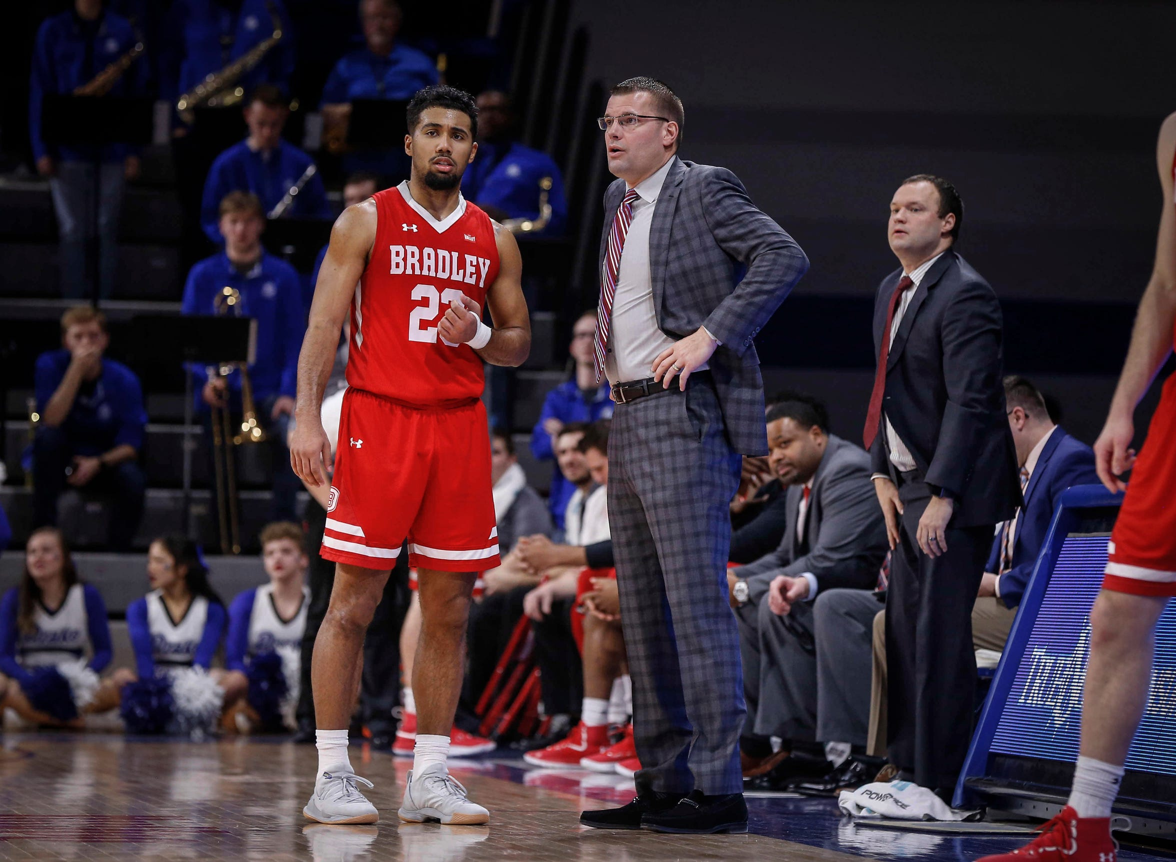 Bradley mens head basketball coach Brian Wardle talks with senior Dwayne Lautier-Ogunleye following a technical foul call in the second half against Drake on Tuesday, Feb. 19, 2019, at the Knapp Center in Des Moines.