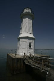The lighthouse. The picture was taken June 15, 2006 at the lighthouse on Grosse Ile on the north side of the island on the Detroit River.  The wooden structure was built in 1906.  this is its 100th year in existence and needs rebuilding.  MARY SCHROEDER/Detroit Free Press.  Architectural tourism story by John Gallagher