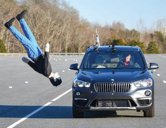 The BMW X1 barrels into a pedestrian in a crash test conducted by the Insurance Institute for Highway Safety.