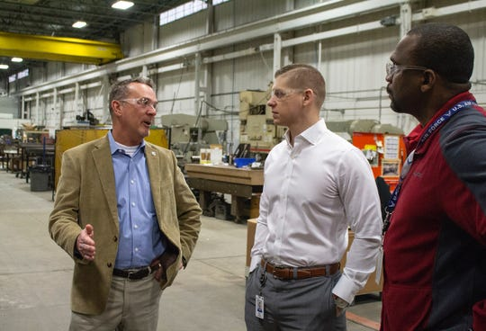 Kyle Jastren (center), a general manager at Roush Manufacturing in Livonia and a former U.S. Marine, talks with David Dunckel (left), an Army veteran and strategy specialist with the Michigan Veterans Affairs Agency, and John Gardner, a U.S. Air Force veteran and manager of Roush's Veterans Initiatives Program.