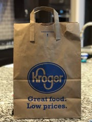 Michigan Kroger stores will stop carrying paper bags with handles starting March 1.