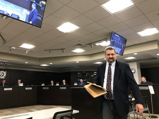 Frank Cusumano, a Macomb County attorney who once represented ousted county Clerk Karen Spranger, finishes addressing county commissioners regarding a proposed forensic audit of Prosecutor Eric Smith's forfeiture funds during a board committee meeting in Mt. Clemens on Feb. 20, 2019.