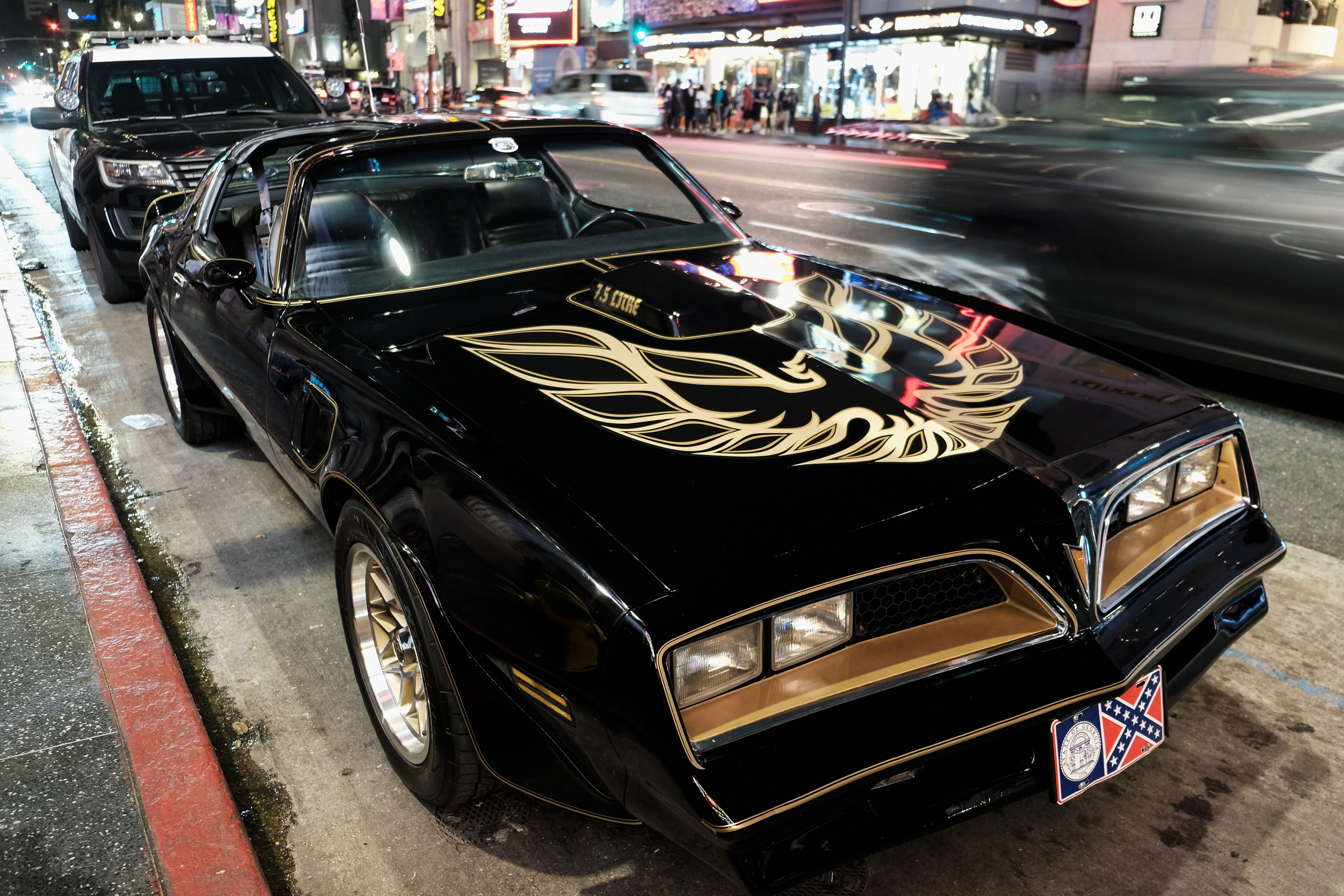"The Pontiac Firebird Trans Am from Burt Reynolds' film ""Smokey and the Bandit"" is seen in front of Burt Reynolds' star on the Hollywood Walk of Fame on Sept. 6, 2018, in Los Angeles."