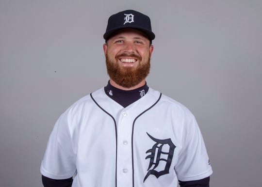 Detroit Tigers relief pitcher Buck Farmer (45) poses for a headshot on media day at Joker Marchant Stadium.