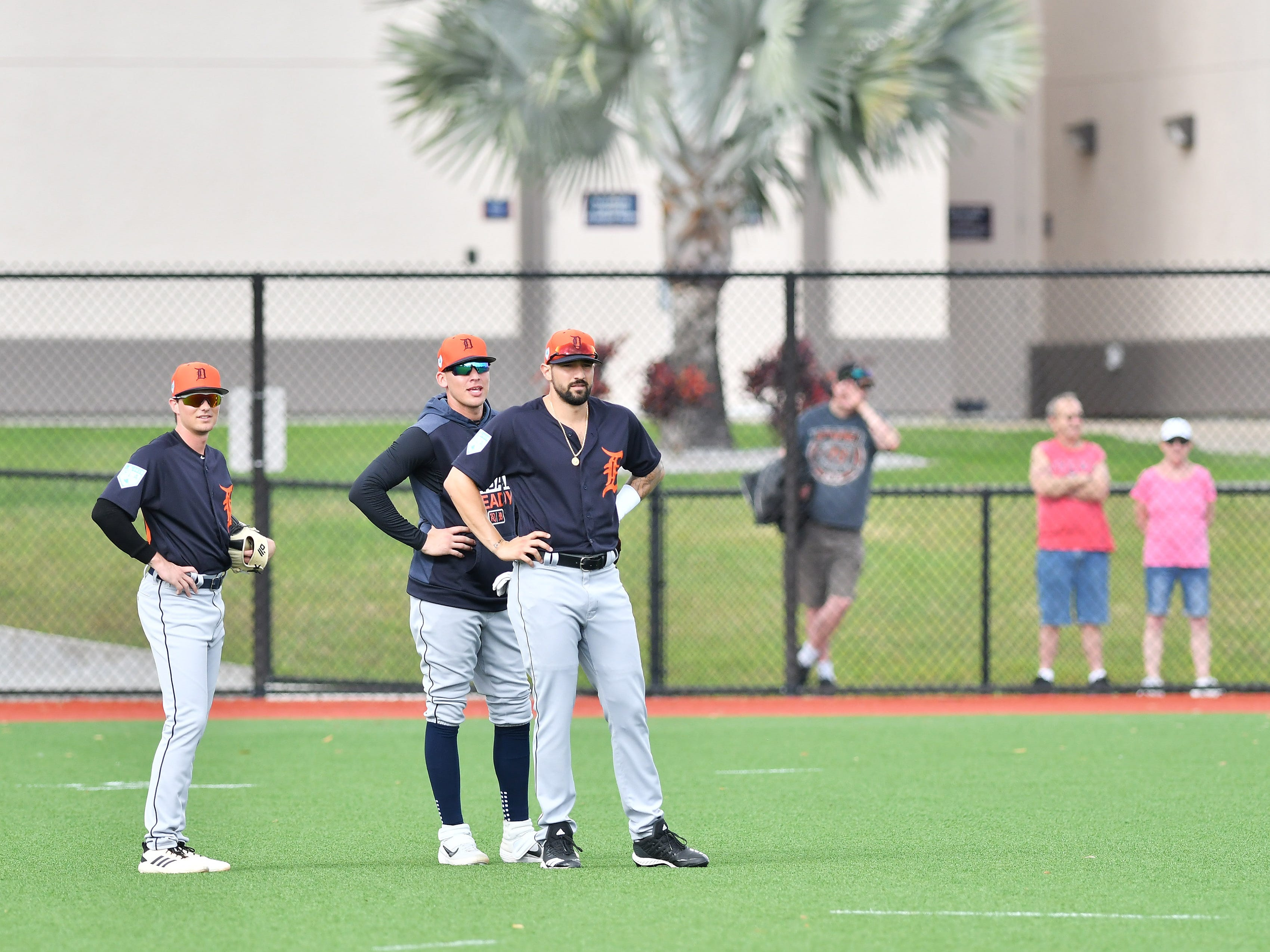 From left, non-roster invitee Danny Woodrow, and Tigers outfielders JaCoby Jones and Nick Castellanos wait for pop flies from third-base coach Dave Clark, not shown, during practice of calling for the fly ball.