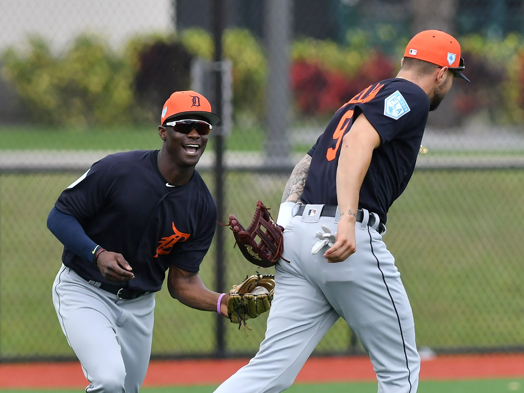 Tigers non-roster invitee Daz Cameron, left, calls off Nick Castellanos and makes the catch during outfield drills.