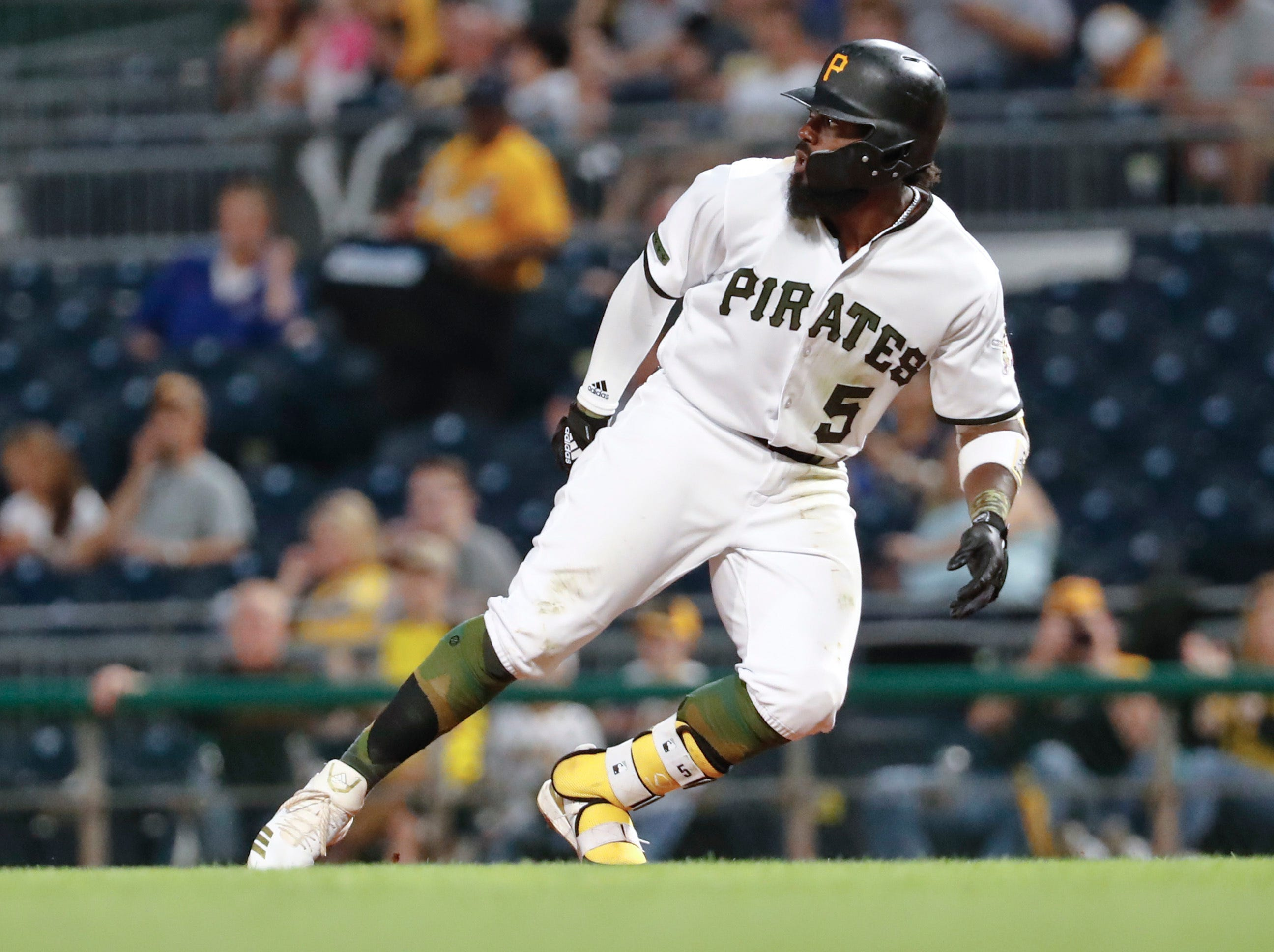 Pittsburgh Pirates' Josh Harrison retreats after rounding first during a baseball game against the Chicago Cubs, Thursday, Aug. 16, 2018, in Pittsburgh.