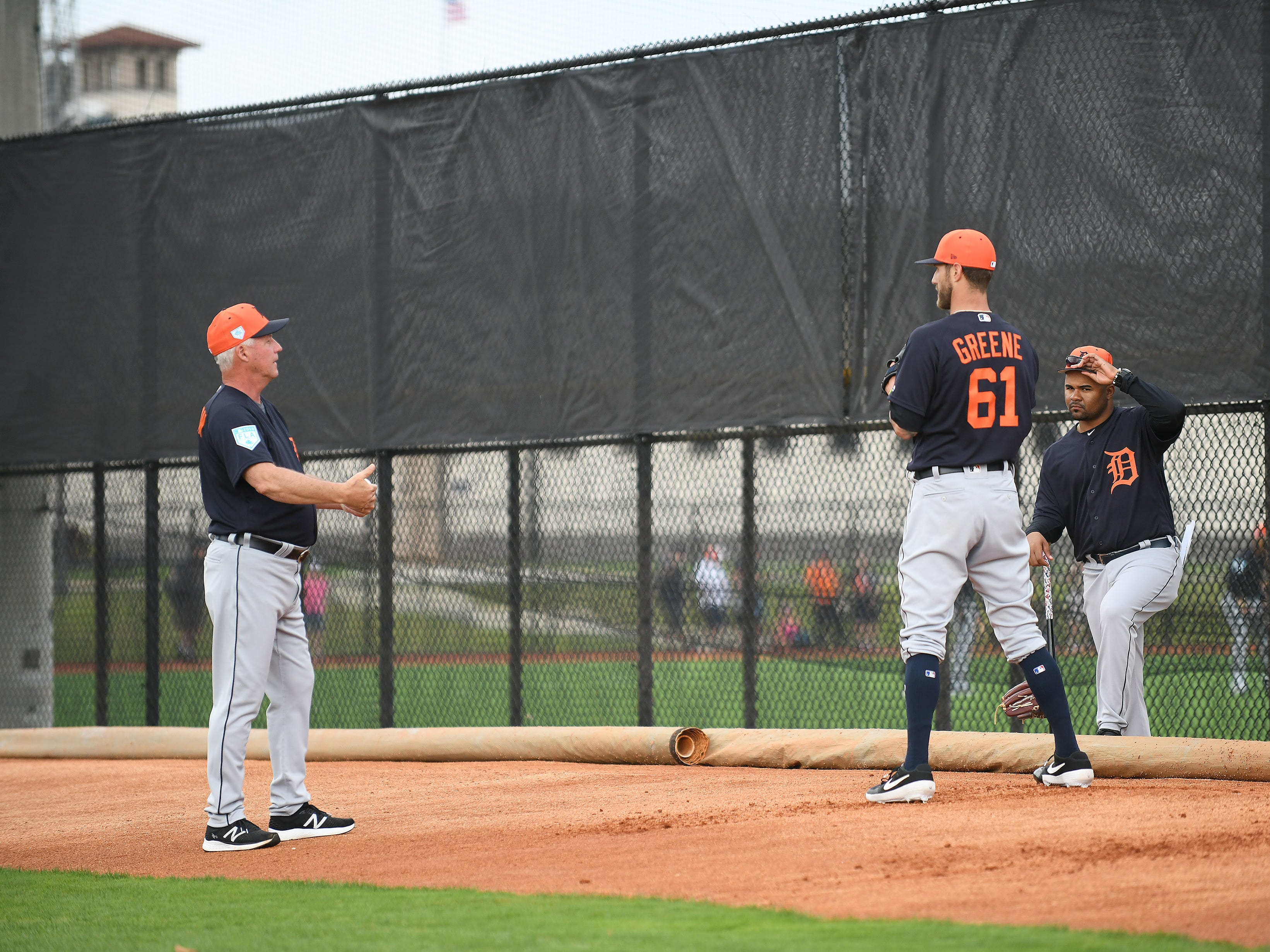 Tigers pitching coach Rick Anderson, left, talks with pitcher Shane Greene during a bullpen session during the  Tigers workout Wednesday, Feb. 20, 2019, at spring training in Lakeland, Fla.
