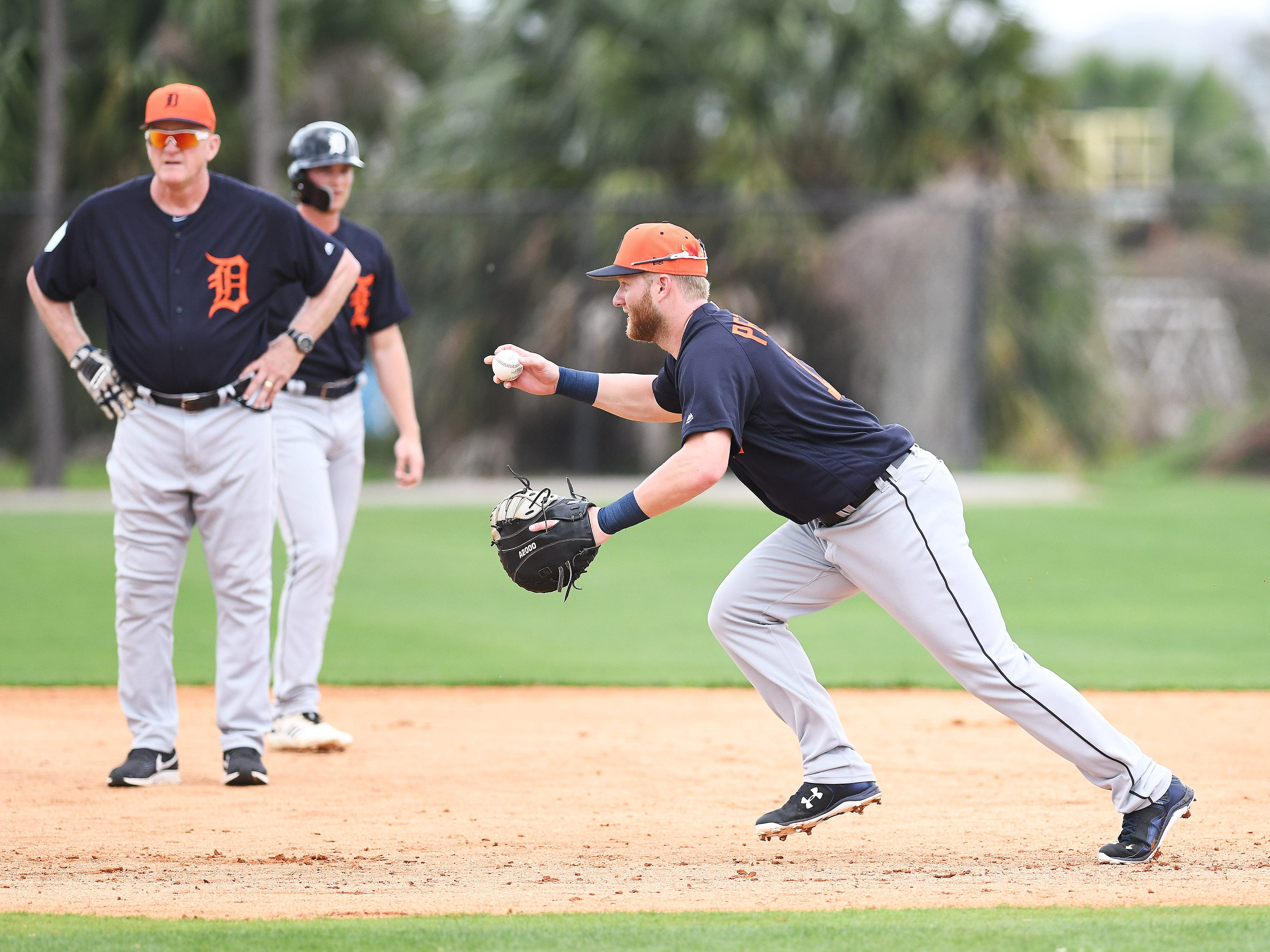 The Tigers' Dustin Peterson starts a rundown during a rundown drill.