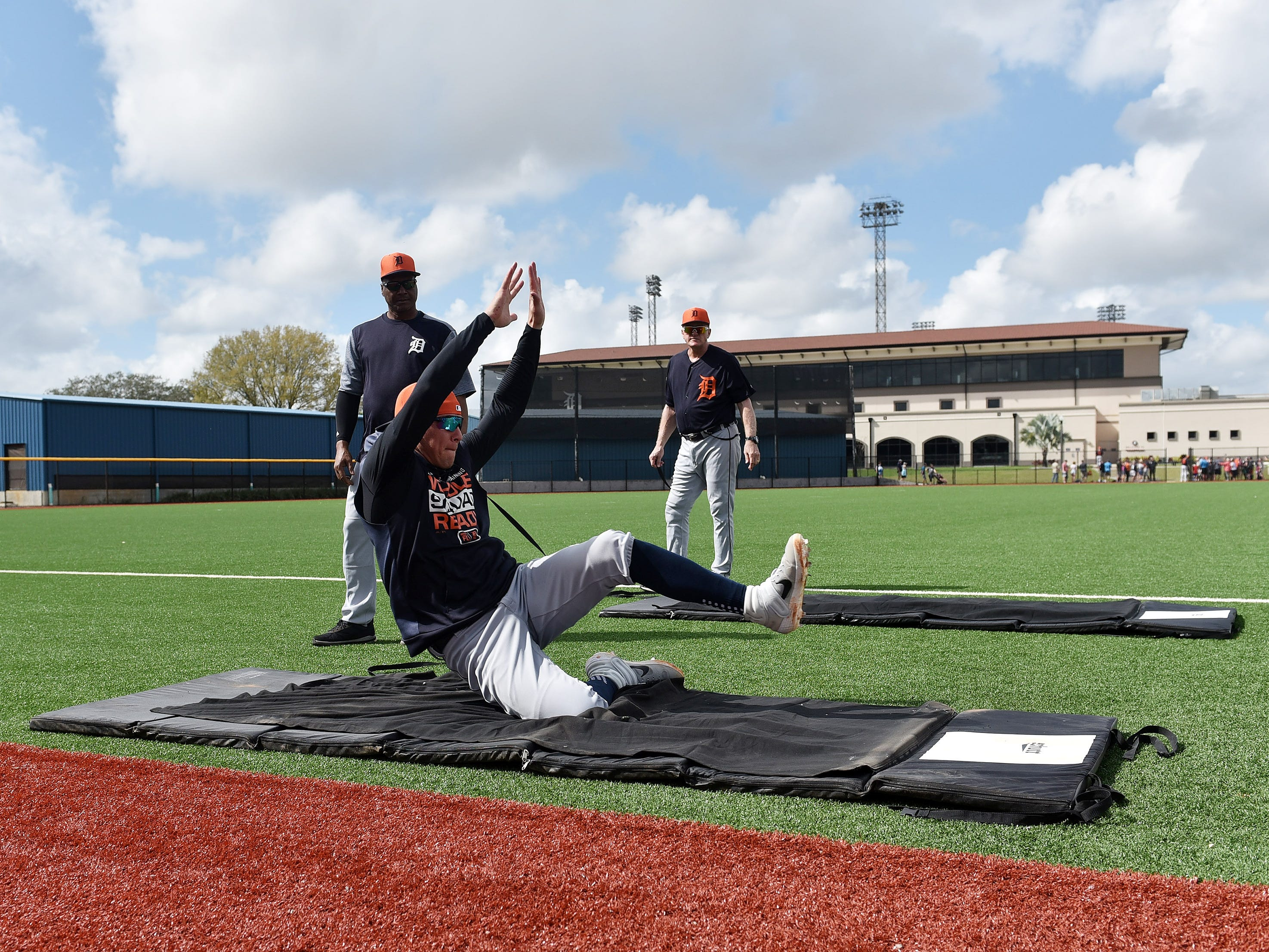 The Tigers' JaCoby Jones practices sliding on the mat.