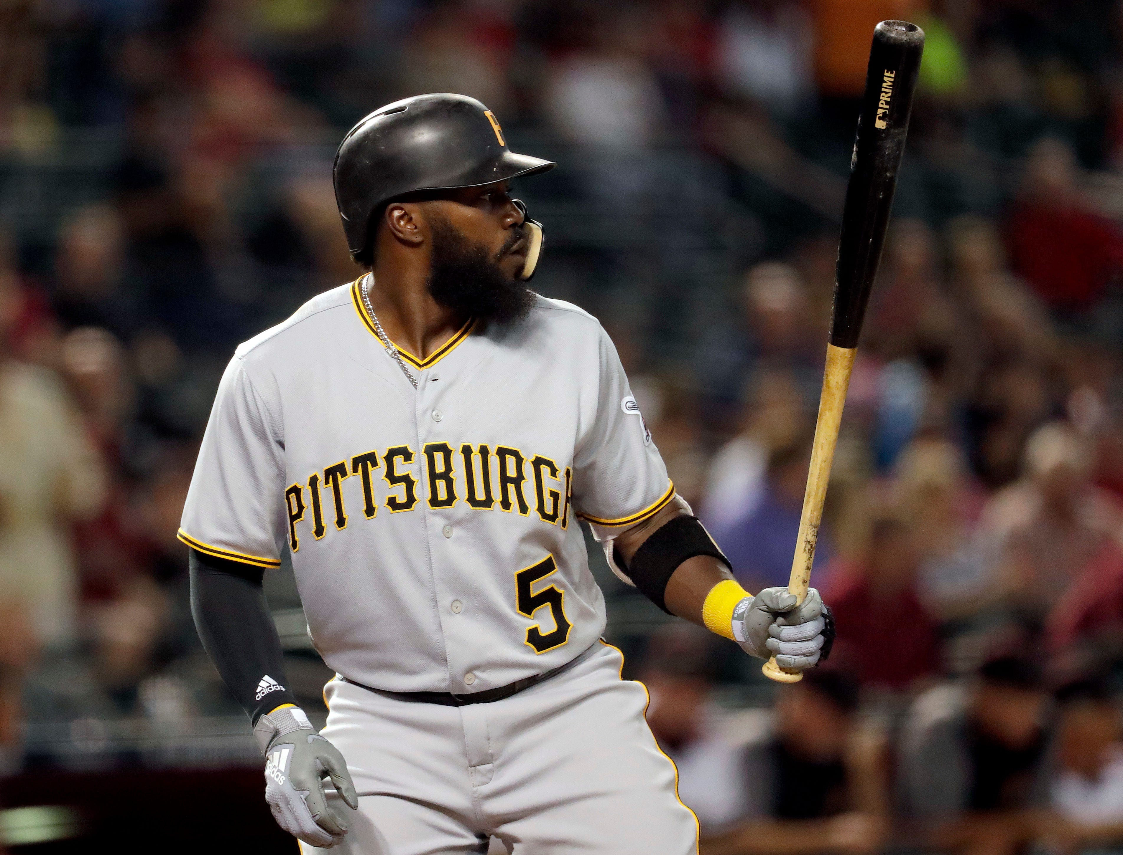 Pittsburgh Pirates' Josh Harrison hits against the Arizona Diamondbacks during the first inning of a baseball game, Monday, June 11, 2018, in Phoenix.