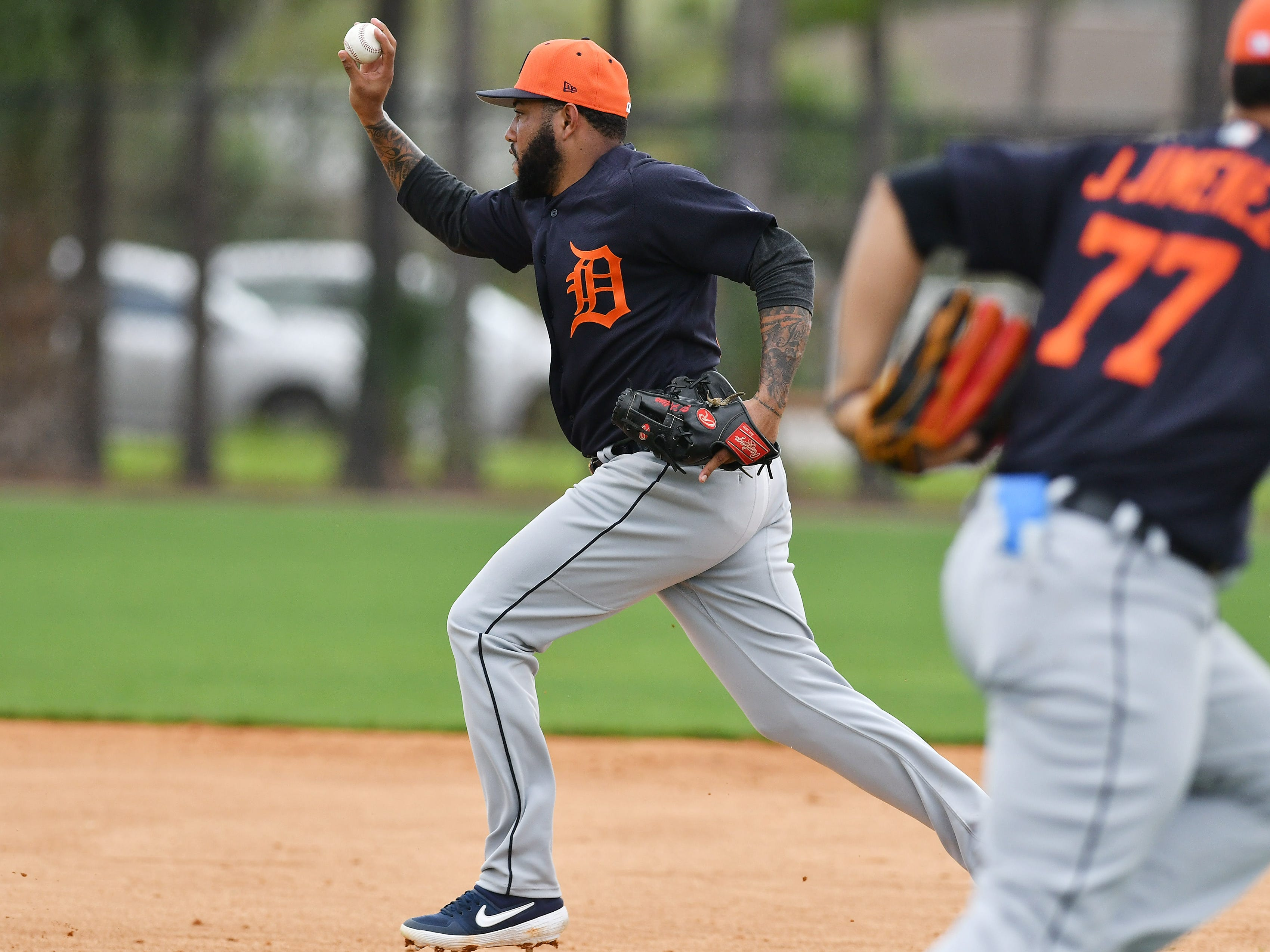 Tigers infielder Ronny Rodriguez runs down a base runner during a drill.