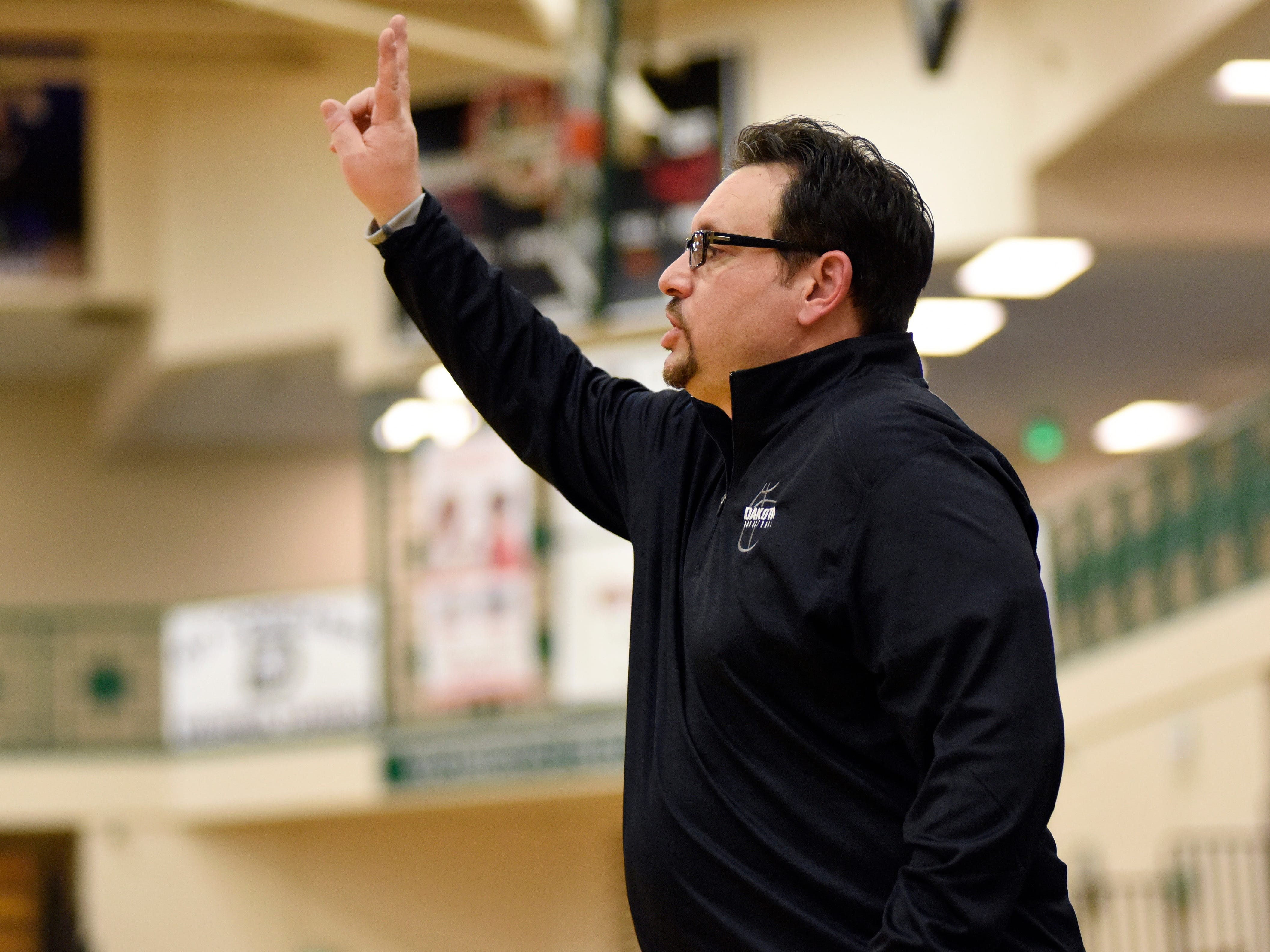 Macomb Dakota boys basketball head coach Paul Tocco calls a play to his team as they played against St Clair during the fourth quarter.