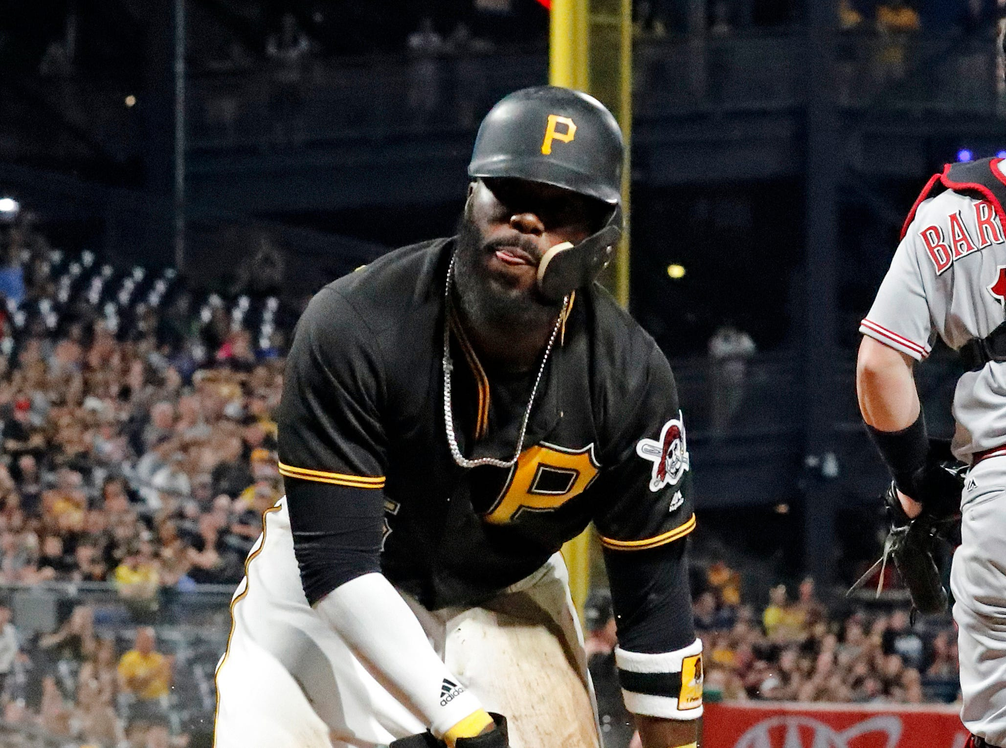 Pittsburgh Pirates' Josh Harrison scores on a sacrifice fly by Colin Moran off Cincinnati Reds relief pitcher Michael Lorenzen during the sixth inning of a baseball game in Pittsburgh, Friday, June 15, 2018.