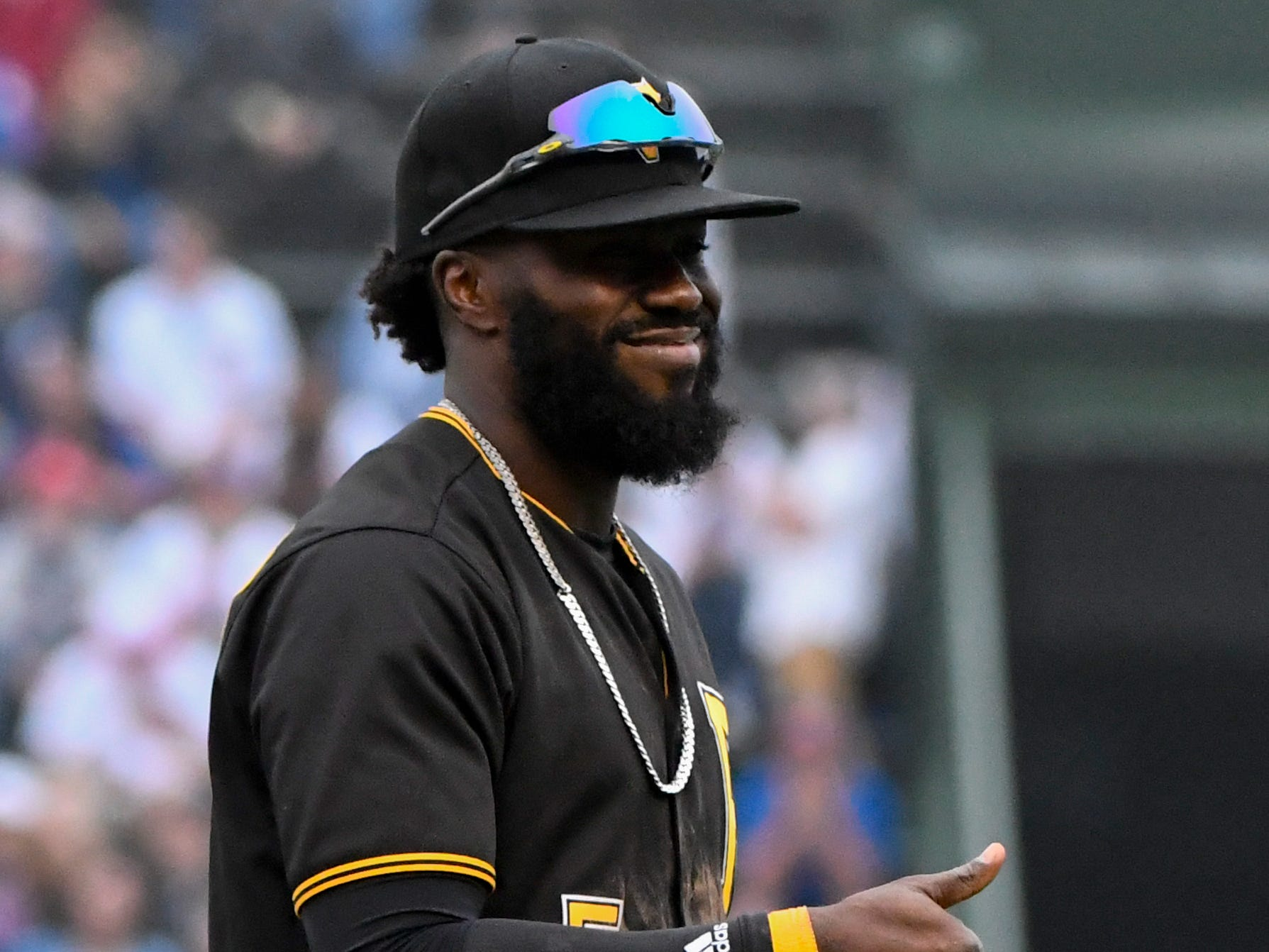 Pittsburgh Pirates second baseman Josh Harrison reacts after he stops a ball hit by Chicago Cubs' Anthony Rizzo during the ninth inning of a baseball game on Sunday, June 10, 2018, in Chicago.