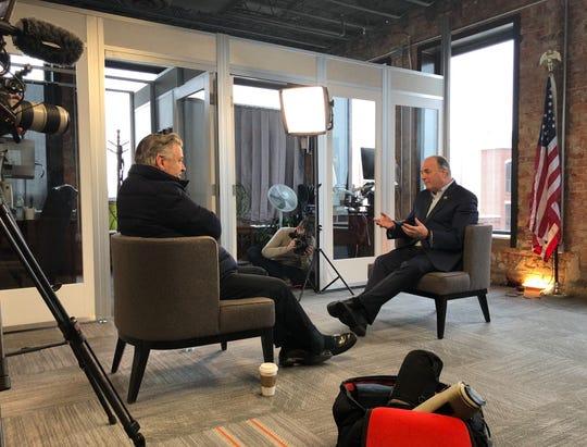 Alec Baldwin (left) interviewing Congressman Dan Kildee Wednesday.