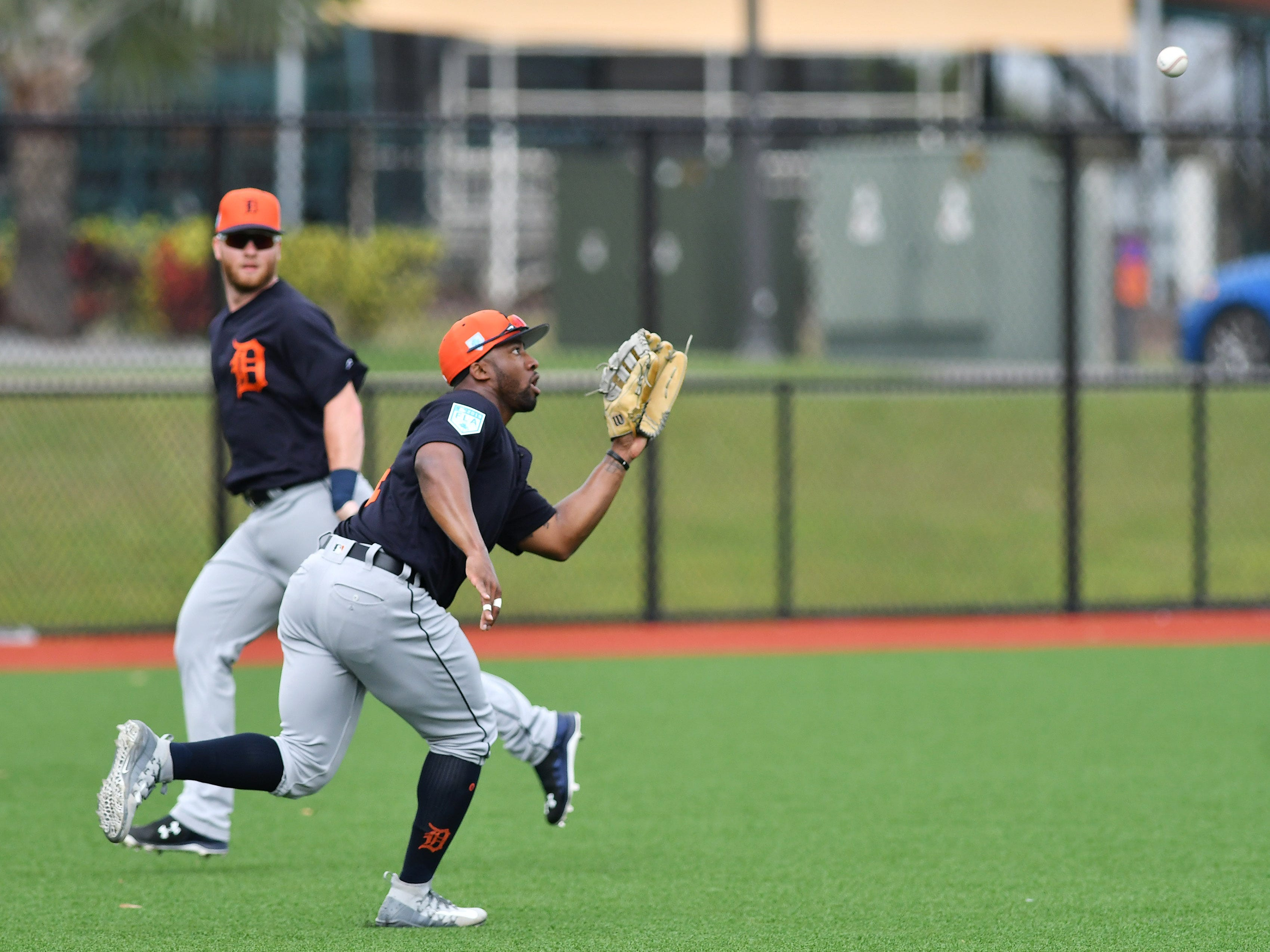 Tigers outfielder Christin Stewart makes a running catch during fly ball drills.