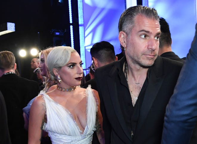Actress Lady Gaga, left, and then-fiance Christian Carino attend the 25th Annual Screen Actors Guild Awards show at the Shrine Auditorium in Los Angeles on January 27, 2019.