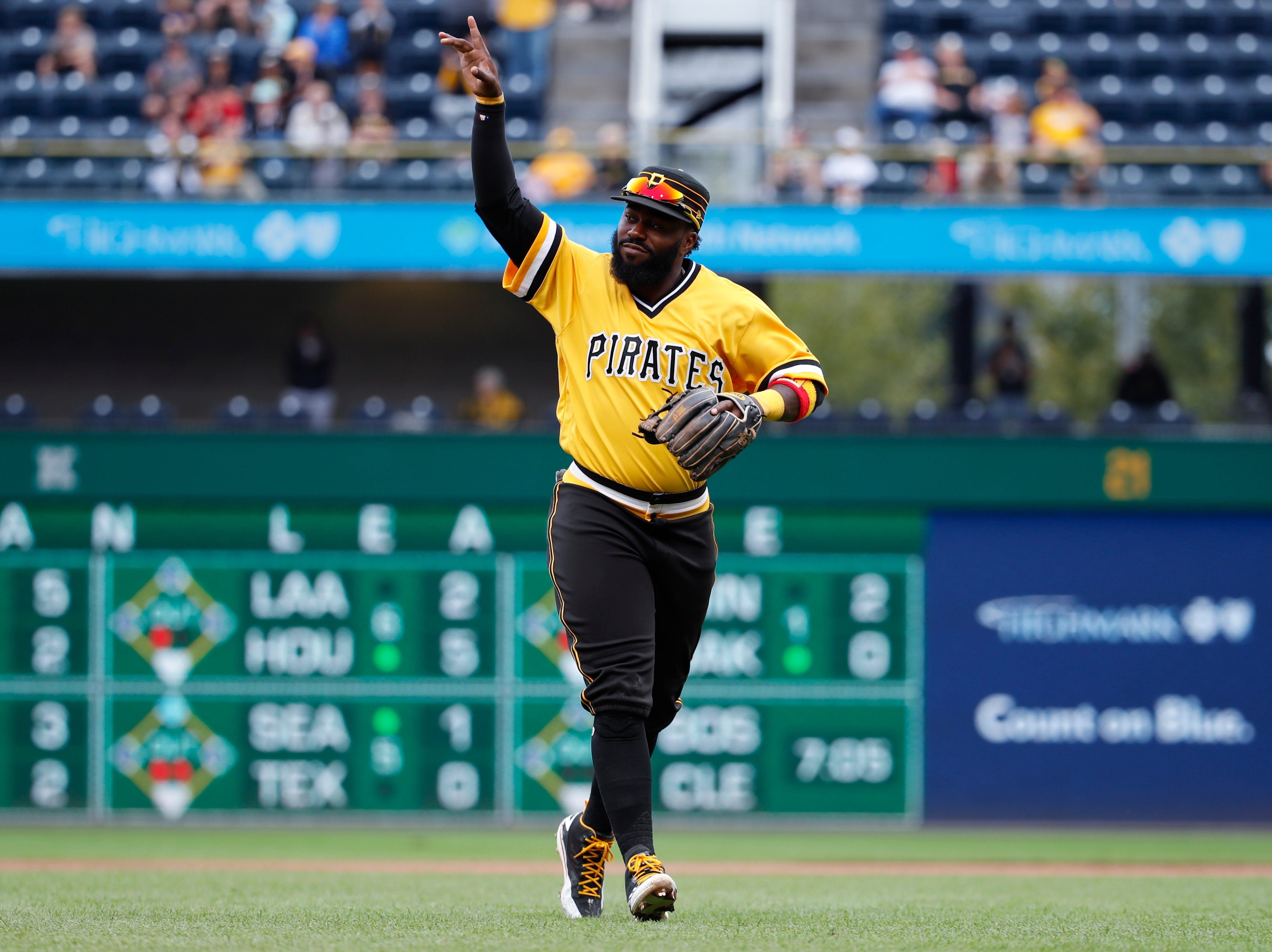 Pittsburgh Pirates second baseman Josh Harrison acknowledges the fans as he leaves the field at PNC Park after being replaced in the eighth inning of the team's baseball game against the Milwaukee Brewers in Pittsburgh on Sept. 23, 2018.