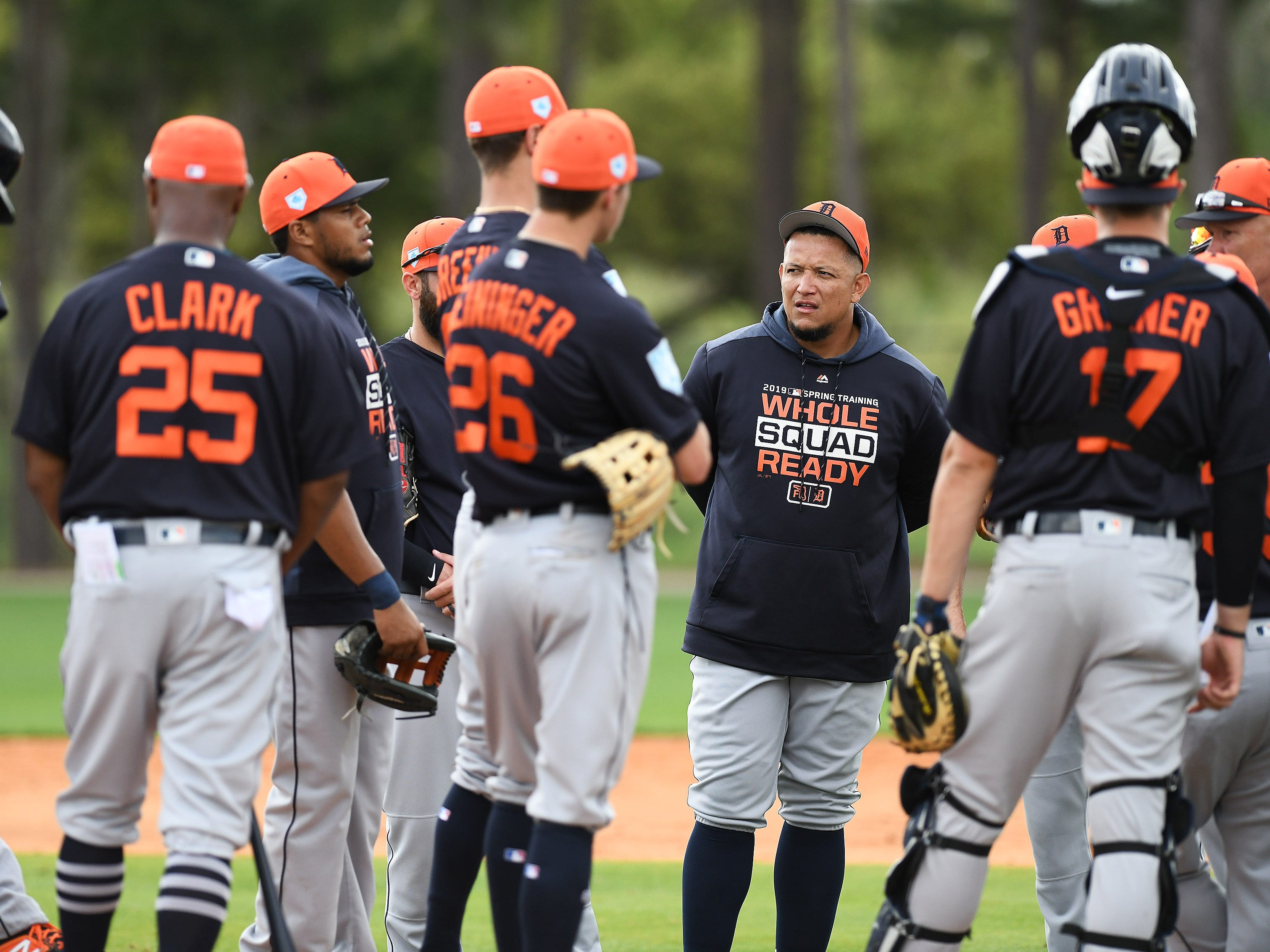 Miguel Cabrera, right facing, gathers  with teammates for instructions during pitchers infield practice.