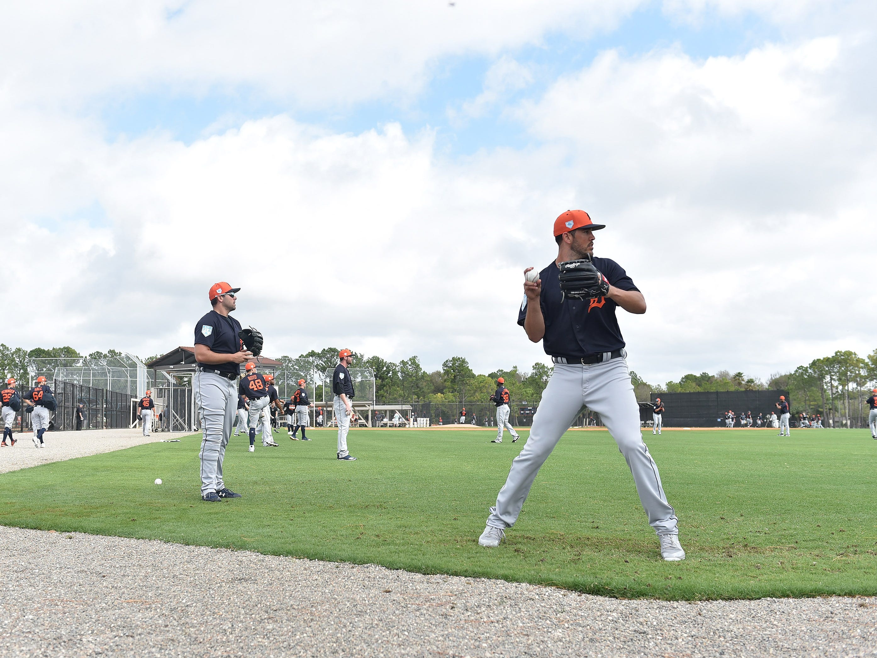 Tigers pitchers Drew VerHagen, right, and Michael Fulmer warm up their arms.