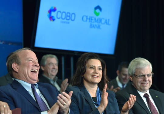 Detroit Mayor Mike Duggan, Michigan Gov. Gretchen Whitmer and Chemical Bank Corp. Chairman Gary Torgow listen to another speaker.