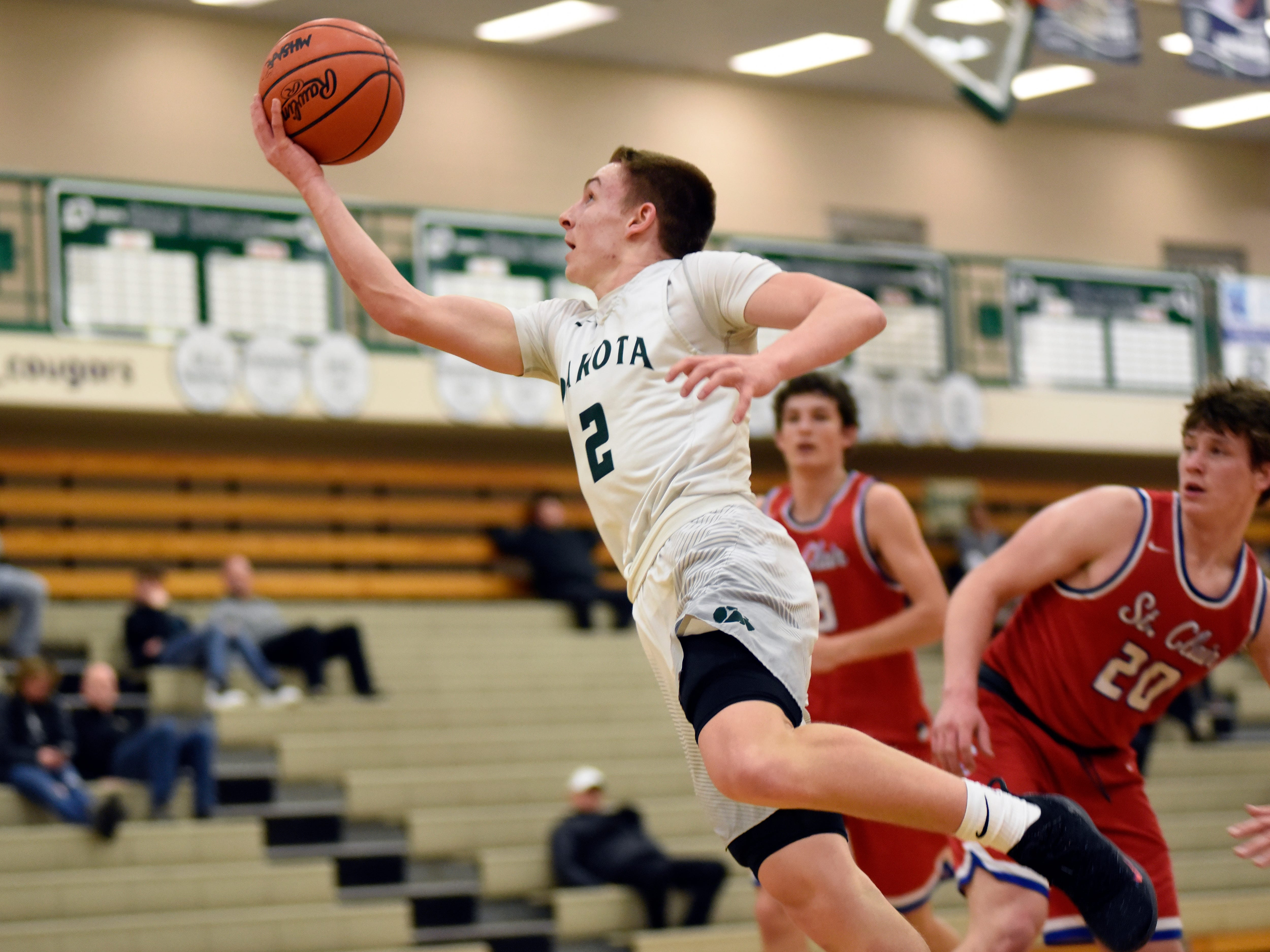 Macomb Dakota guard Mark Tocco goes in for a layup against St Clair during the third quarter.