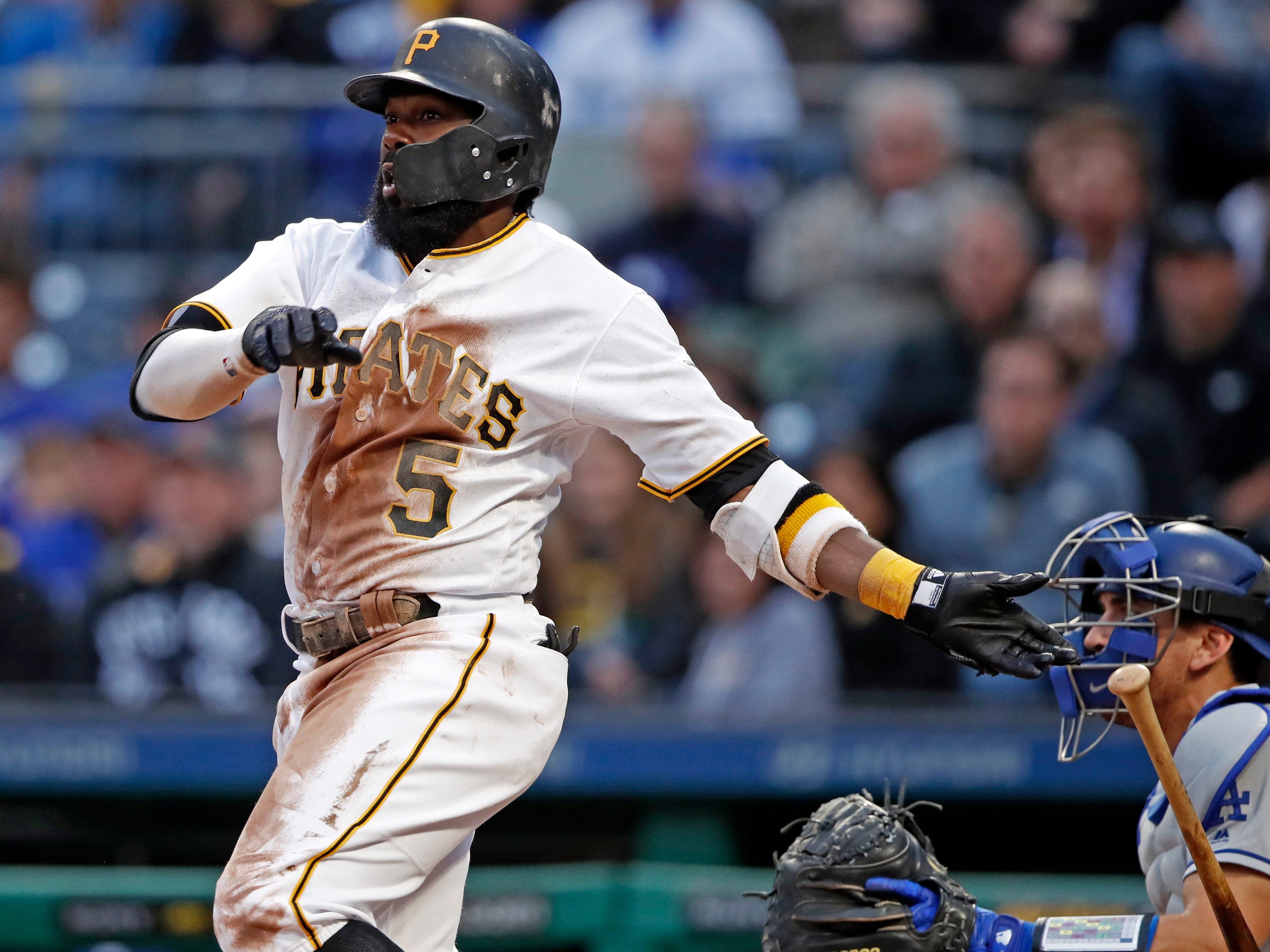 Pittsburgh Pirates' Josh Harrison watches his three-run double off Los Angeles Dodgers starting pitcher Caleb Ferguson during the second inning of a baseball game in Pittsburgh, Wednesday, June 6, 2018.