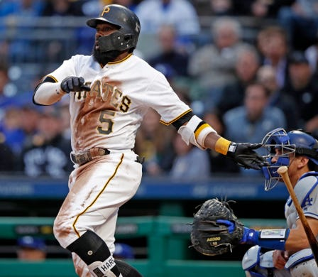 cb5079ef0 Pittsburgh Pirates  Josh Harrison watches his three-run double off Los  Angeles Dodgers starting