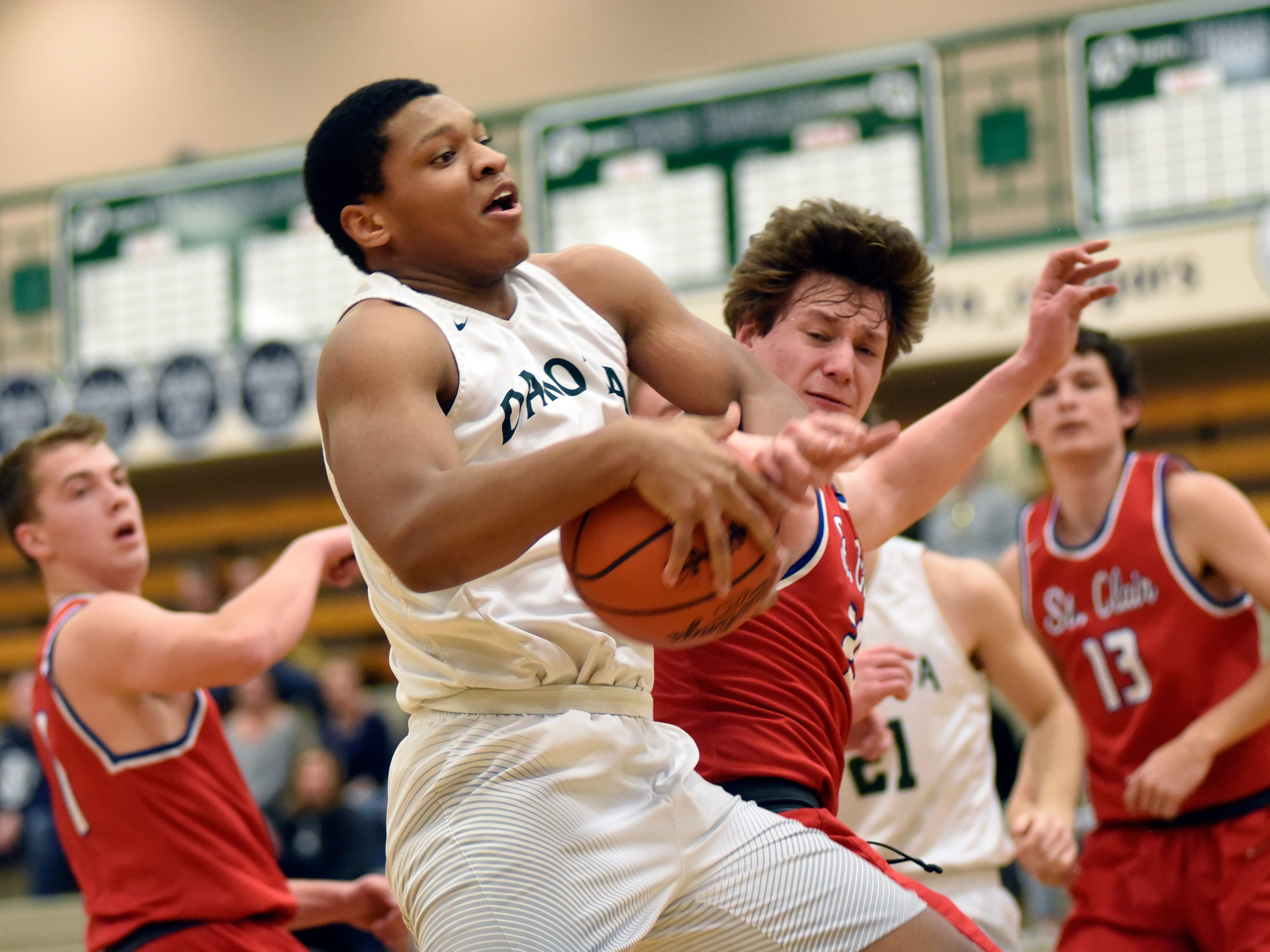 Macomb Dakota forward Jeremiah Major grabs a rebound in front of St Clair's Brady Gleason during the first quarter, at Dakota HS in Macomb Township, Feb. 19, 2019.  Macomb defeated St. Clair 80-57.