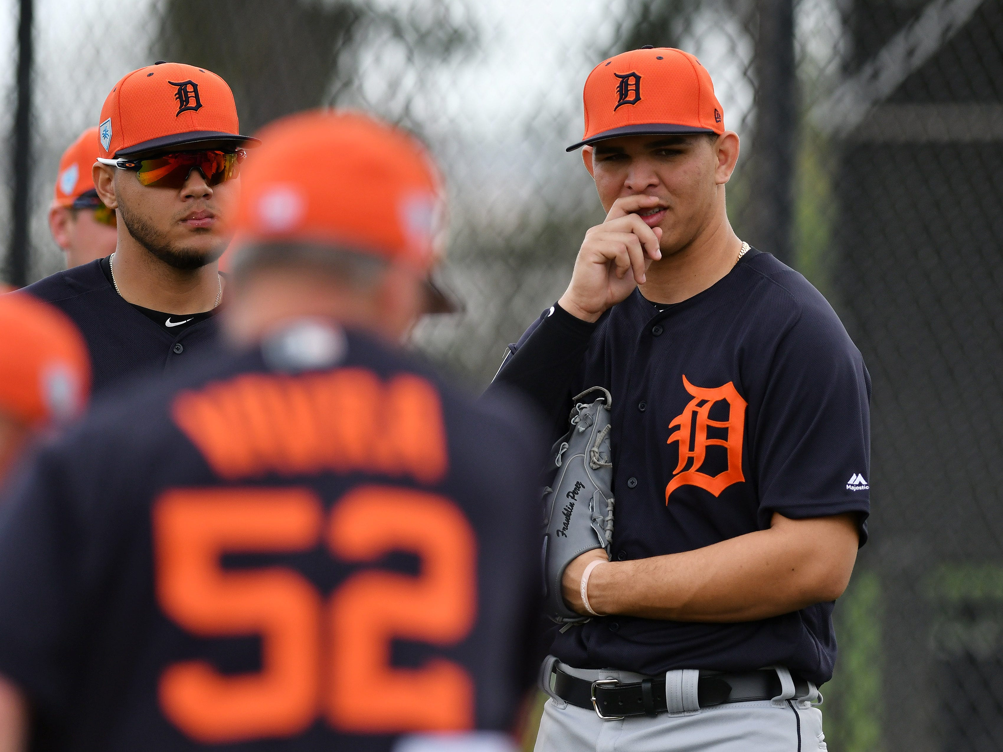 Tigers pitcher Franklin Perez, who has been out sick for a couple of days, listens to quality control coach Joe Vavra (52).