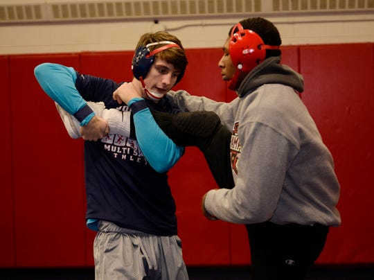 Brenten Polk, left, and Kyle Borthwell practice their moves as Westland John Glenn gets ready for the team finals.