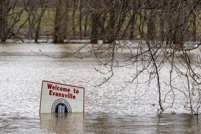 """High water reaches a """"Welcome to Evansville"""" sign seen along Waterworks Road in Evansville, Tuesday afternoon, Feb. 19, 2019. The Ohio River is expected to flood stage this Friday, March 5, 2021."""
