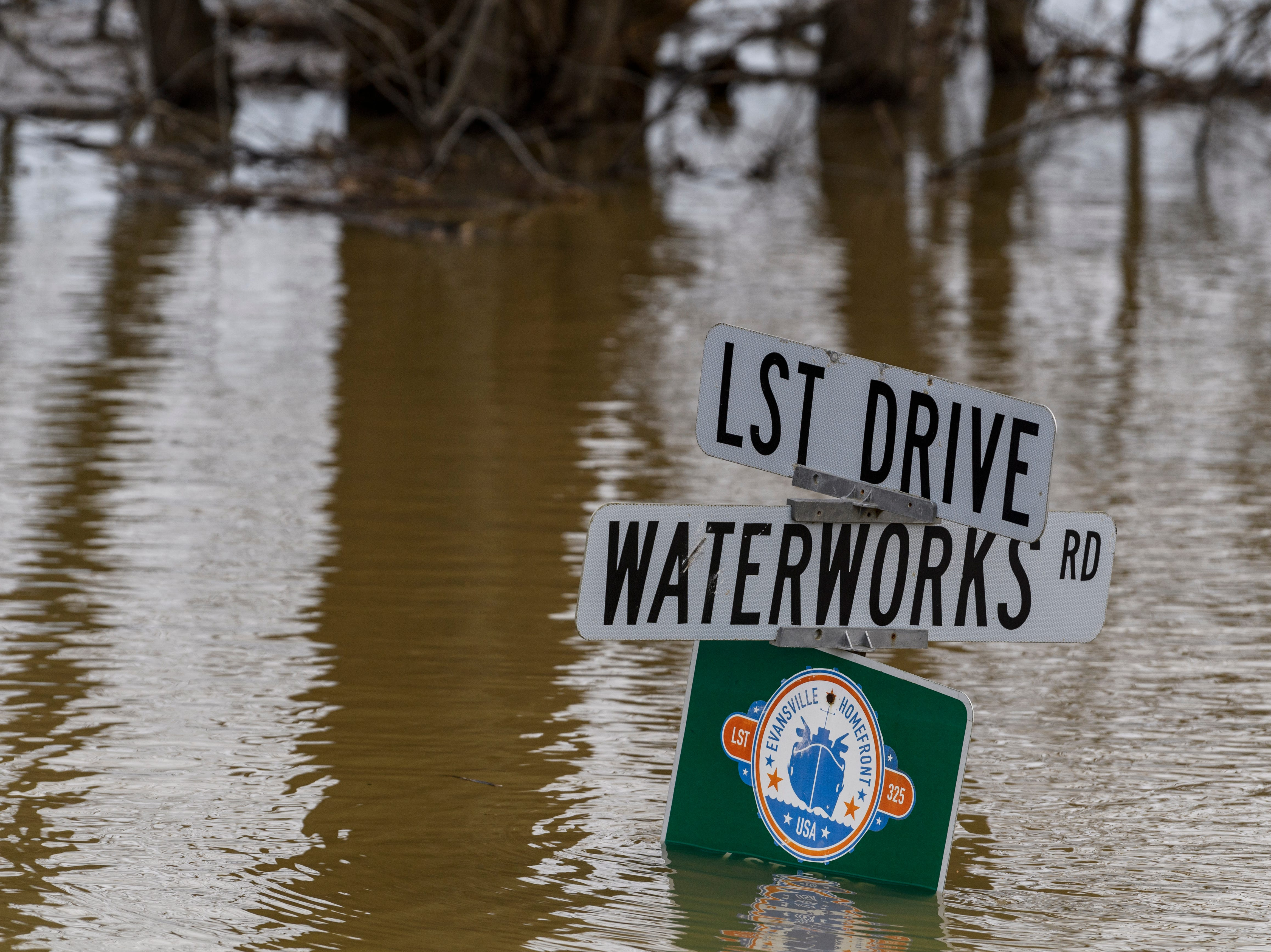 High water covers a large section of Waterworks Road at the intersection of LST Drive in Evansville, Ind., Tuesday, Feb. 19, 2019.