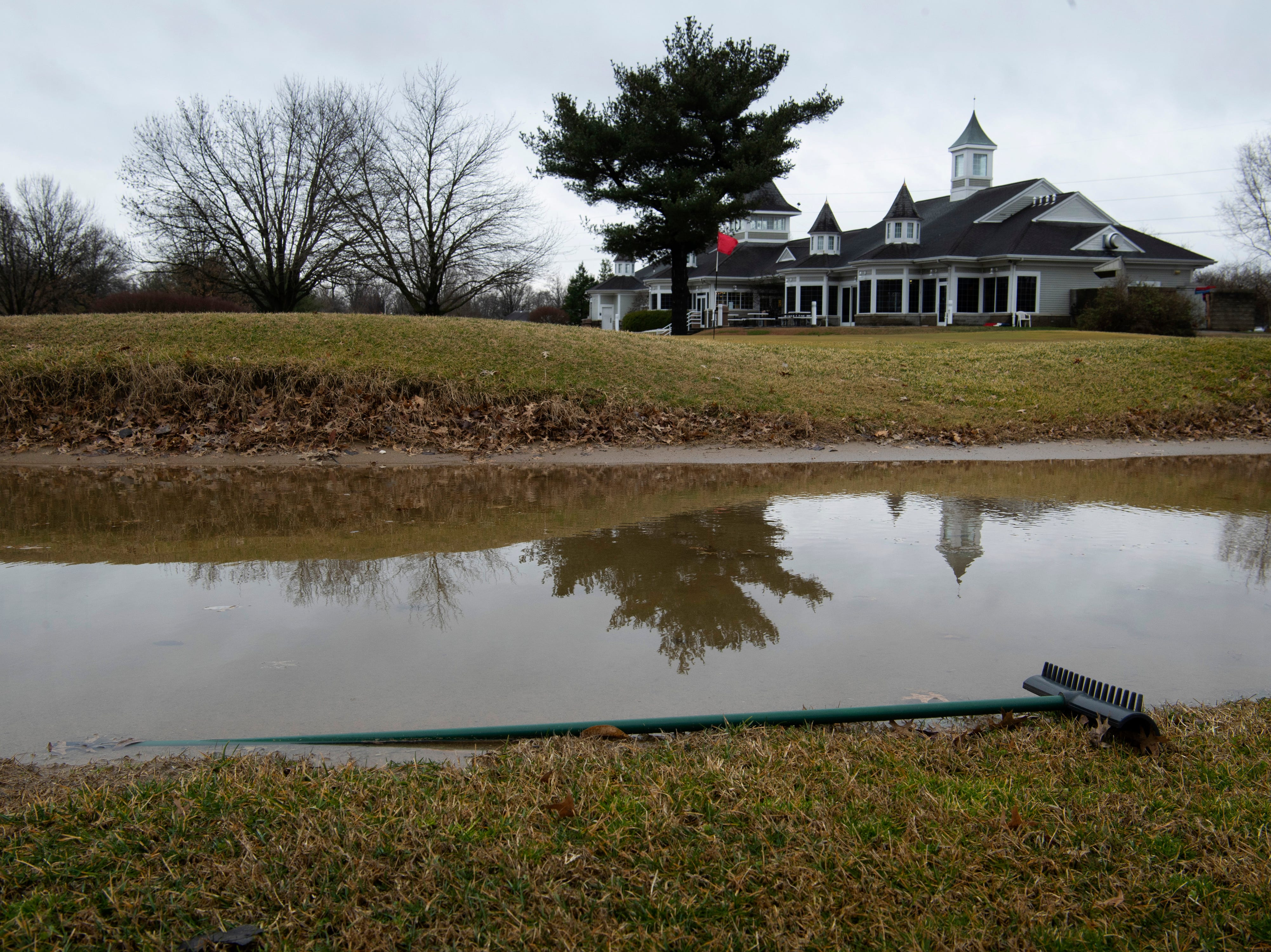The bunker at the 4th green has turned into a water hazard at Fendrich Golf Course in Evansville Wednesday morning. Heavy rain and the rising Pigeon Creek has left nearly half of the course's holes underwater.