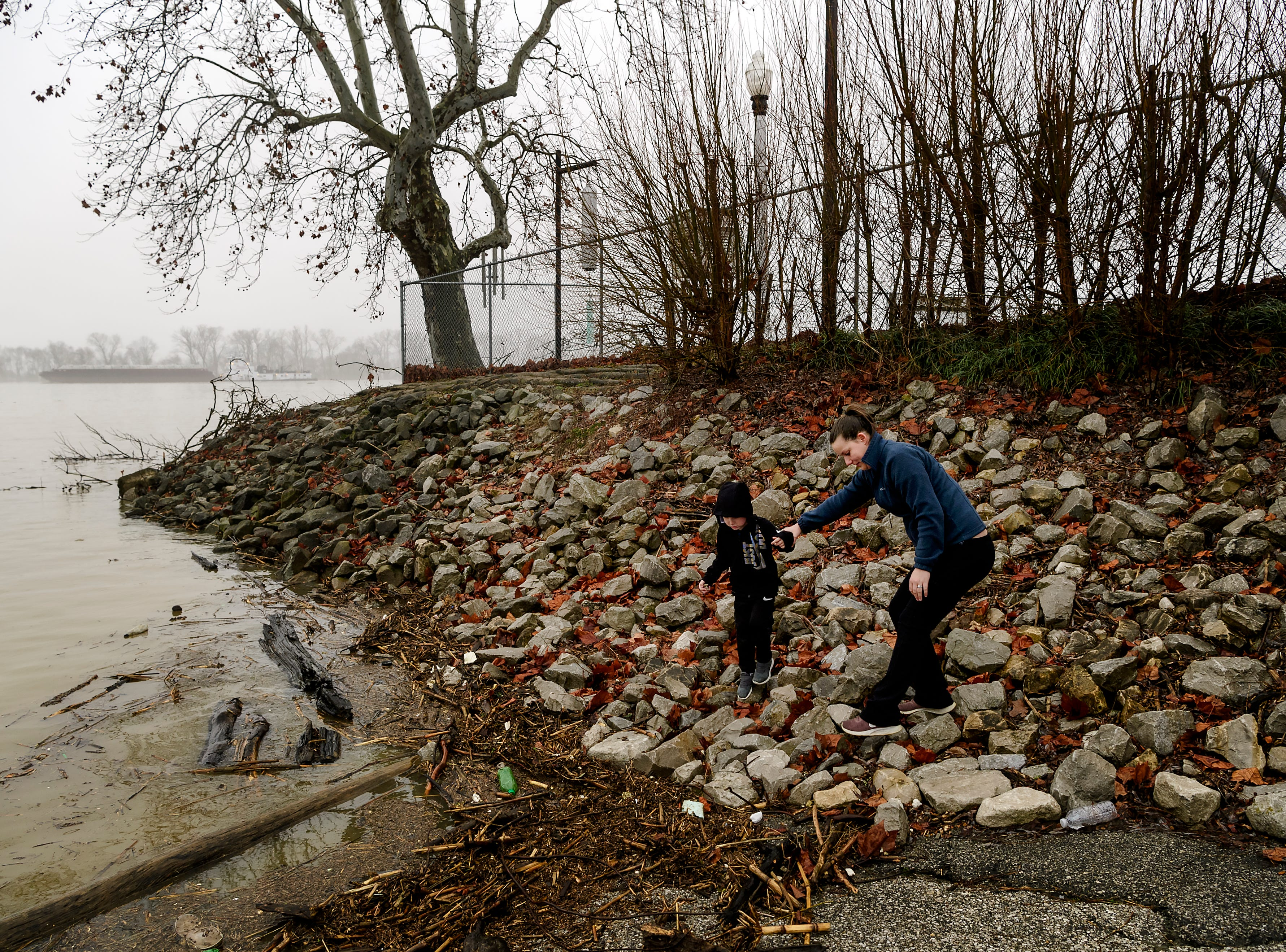 Four-year-old Camden and his mother Sherri Rye of Mt. Vernon walk along the banks of the Ohio River to check out how high the water level has risen near Riverbend Park in downtown Mt. Vernon, Ind., Wednesday, Feb. 20, 2019. According to the National Weather Service, the flood stage was measured at 46 feet in Mount Vernon at 6 a.m. Wednesday.