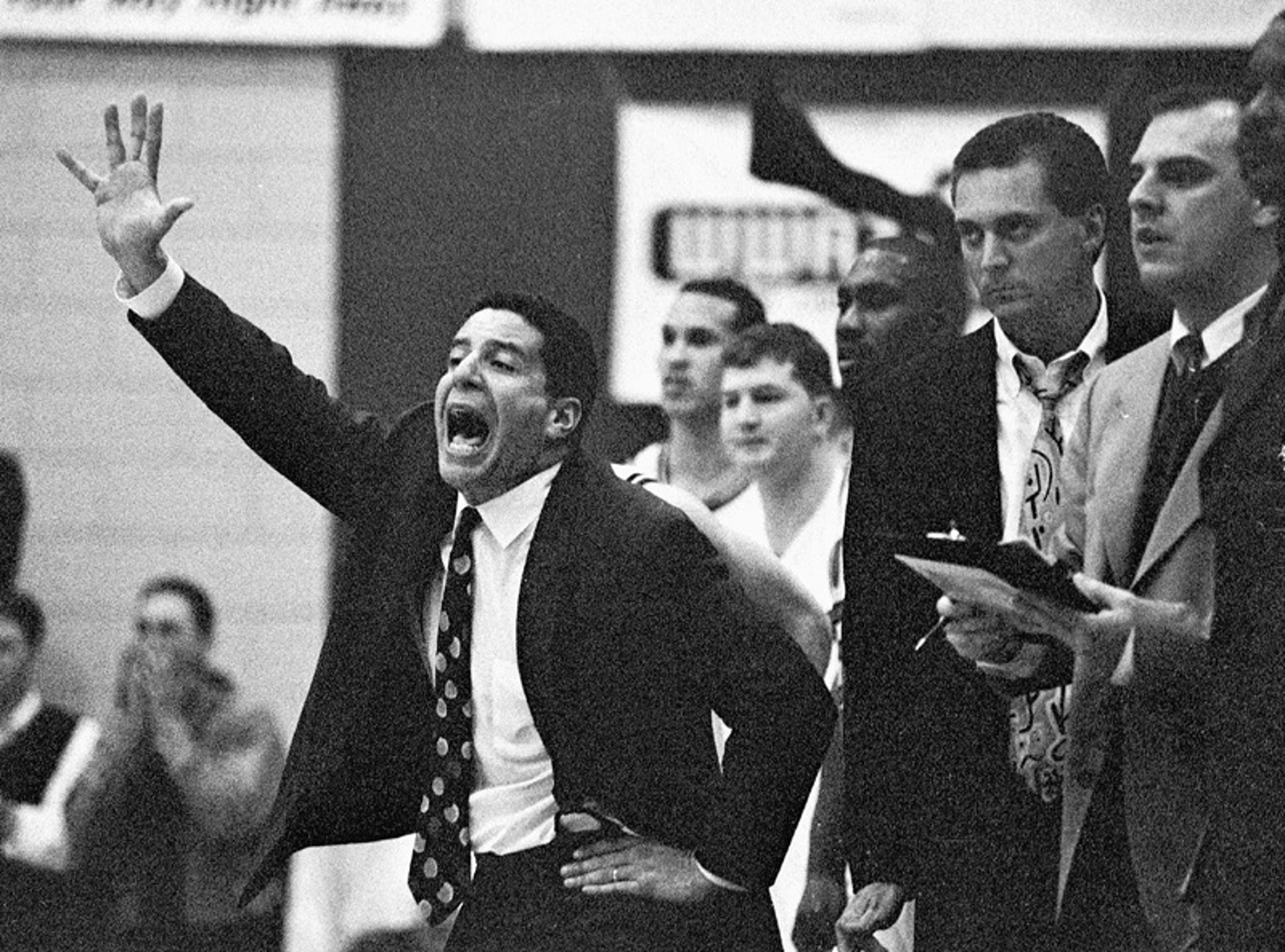 Former USI coach Bruce Pearl, with then-assistant coach Rick Herdes to his left. Herdes would take over coaching USI when Pearl left for Wisconsin-Milwaukee.