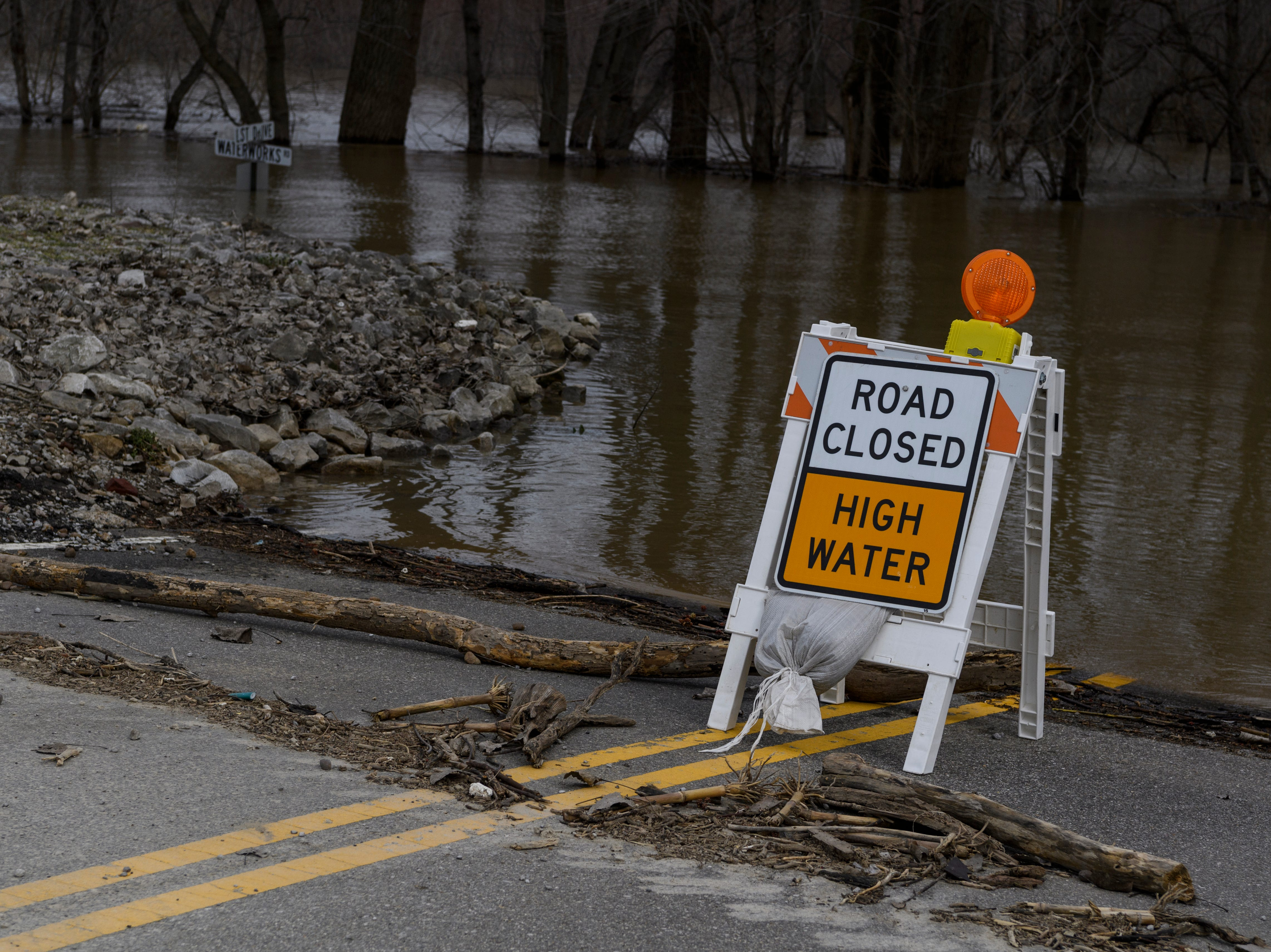 High water covers the intersection of LST Drive and Waterworks Road in Evansville, Ind., Tuesday afternoon, Feb. 19, 2019.