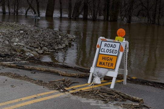 A road closed for high water sign. (File photo)