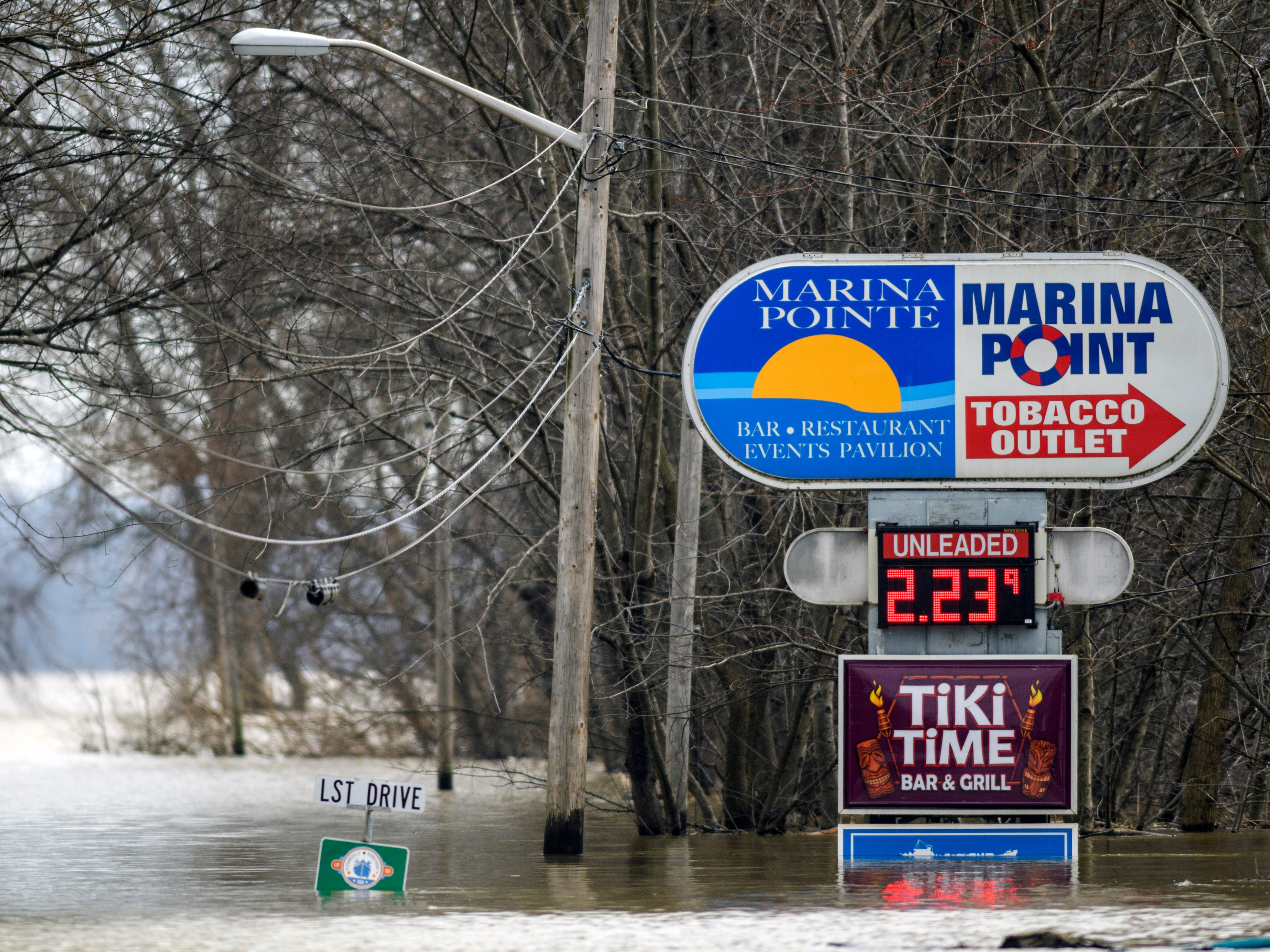 High water covers Waterworks Road near the intersection of LST Drive in Evansville, Ind., Tuesday afternoon, Feb. 19, 2019.