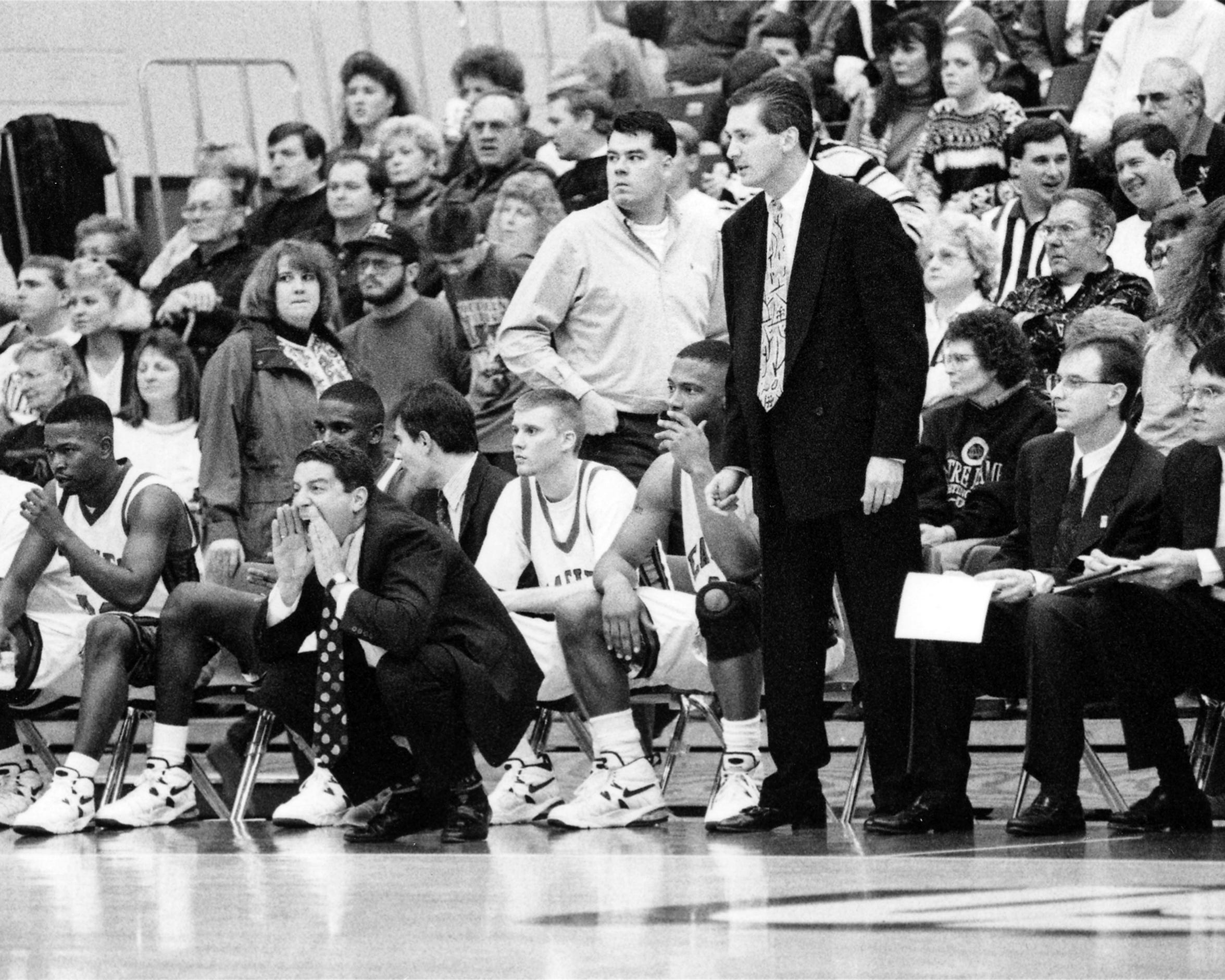 Bruce Pearl (squatting) and Rick Herdes coaching USI in the 1990s.