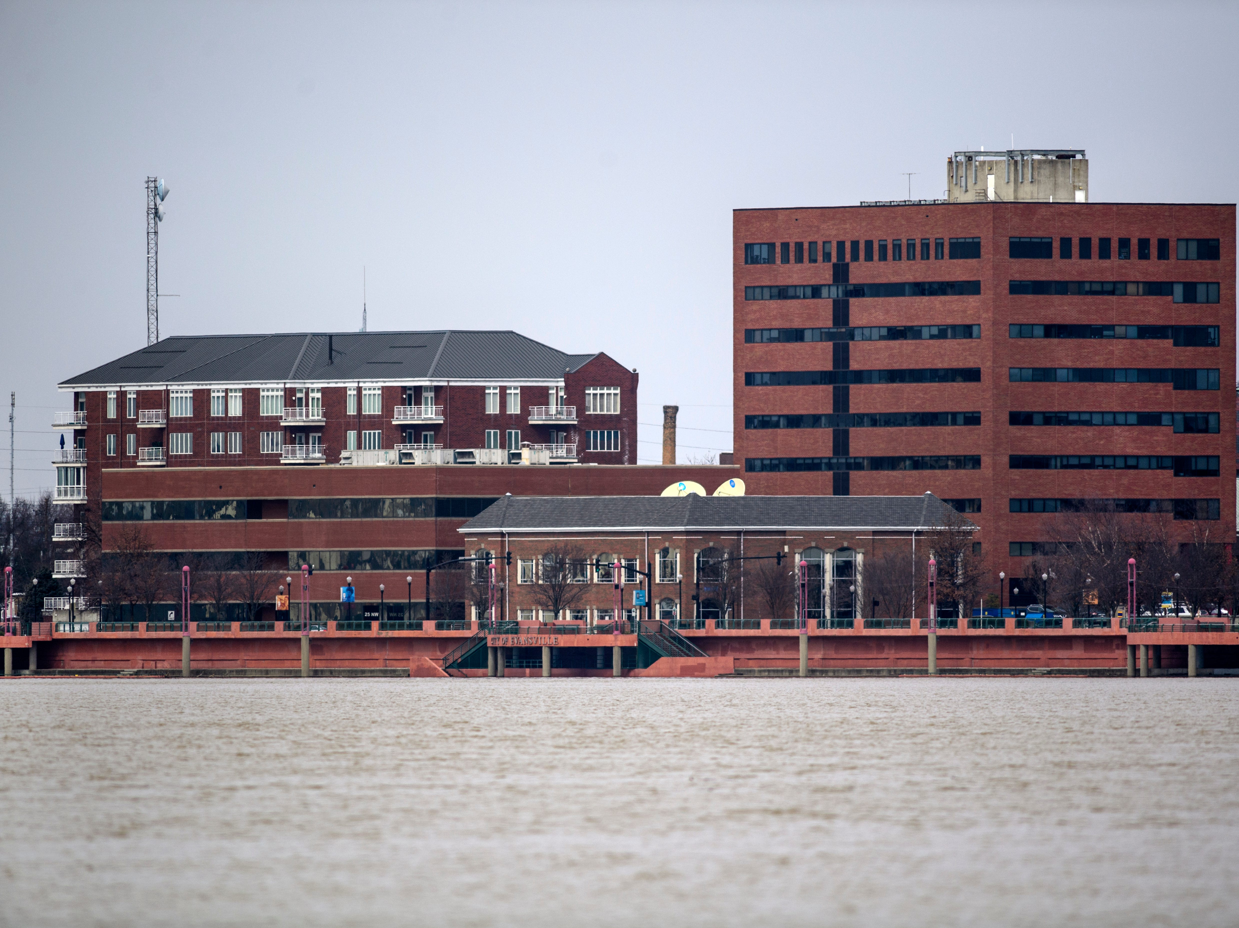 High water covers a majority of Dress Plaza located along the Ohio Riverfront in Downtown Evansville, Ind., Tuesday, Feb. 19, 2019.