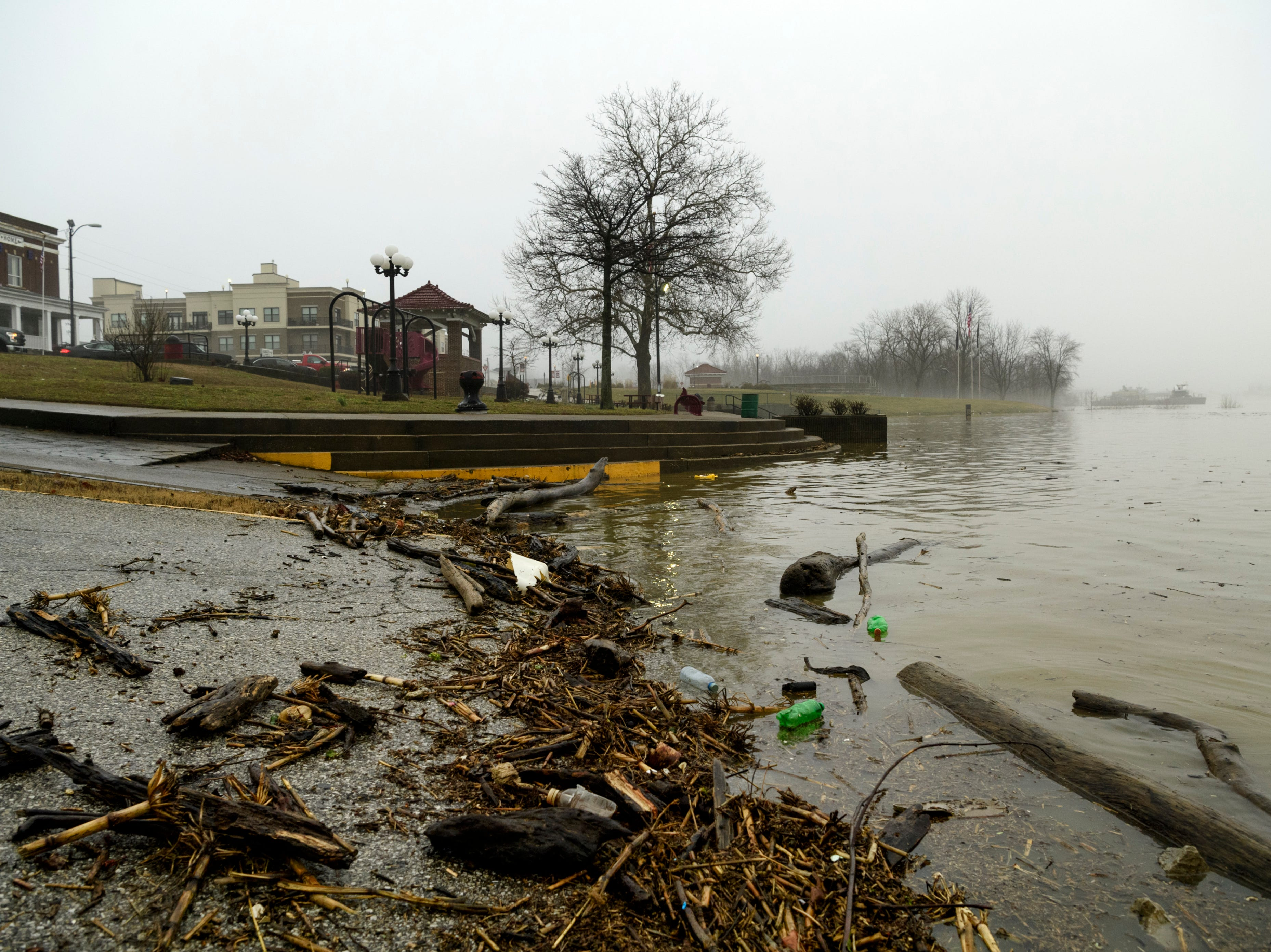 Driftwood litters the ground at Riverbend Park in downtown Mt. Vernon, Ind., Wednesday, Feb. 20, 2019. According to the National Weather Service, the flood stage was measured at 46 feet in Mount Vernon at 6 a.m. Wednesday.
