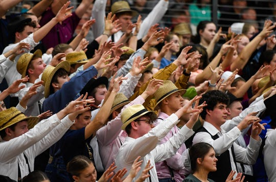 """The Barr-Reeve student section in traditional Mennonite-Amish dress as they cheer-on the Vikings during the annual """"Buggy Bowl"""" rivalry game with the North Daviess Cougars Saturday, January 19, 2019."""