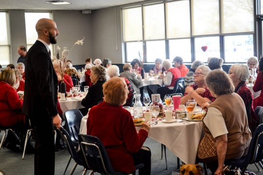8110  Pastor Ryan Morter was one of many local pastors, as well as volunteers from Light House Sober Living, who walked from table to table talking and making jokes with  the women.