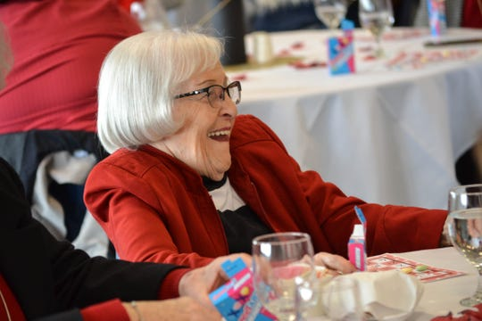A guest reacts to Pastor Ryan Morter's comments during the luncheon. Many of the women expressed surprise over the elegance of the event, which included fresh flowers and a lunch prepared by locally renowned Chef Stacy Maple of Bistro 163.