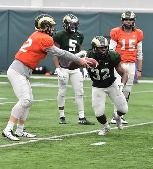 Quarterbacks Patrick O'Brien, left, and Collin Hill (15) and running backs Marvin Kinsey (5) and Marcus McElroy (32) will be some of the key players to keep an eye on during CSU football's final spring scrimmage Thursday evening.