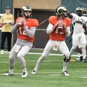 CSU quarterbacks Patrick O'Brien, left, and Collin Hill, who are battling for the starting job next fall, lock in on their respective receivers during a drill in practice Feb. 19, 2019, at the Indoor Practice Facility. (Kelly Lyell/Staff)