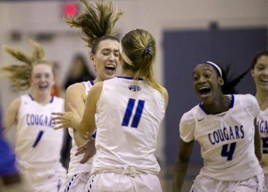 Canterbury School girls basketball players celebrate their win over Bradenton Christian in the Class 3A regional finals on Tuesday, Feb. 19, 2019, at Canterbury School in Fort Myers.
